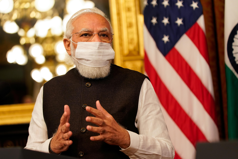 Indian Prime Minister Narendra Modi delivers remarks beside U.S. Vice President Kamala Harris inside the Eisenhower Executive Office Building at the White House in Washington, U.S., September 23, 2021. REUTERS/Elizabeth Frantz
