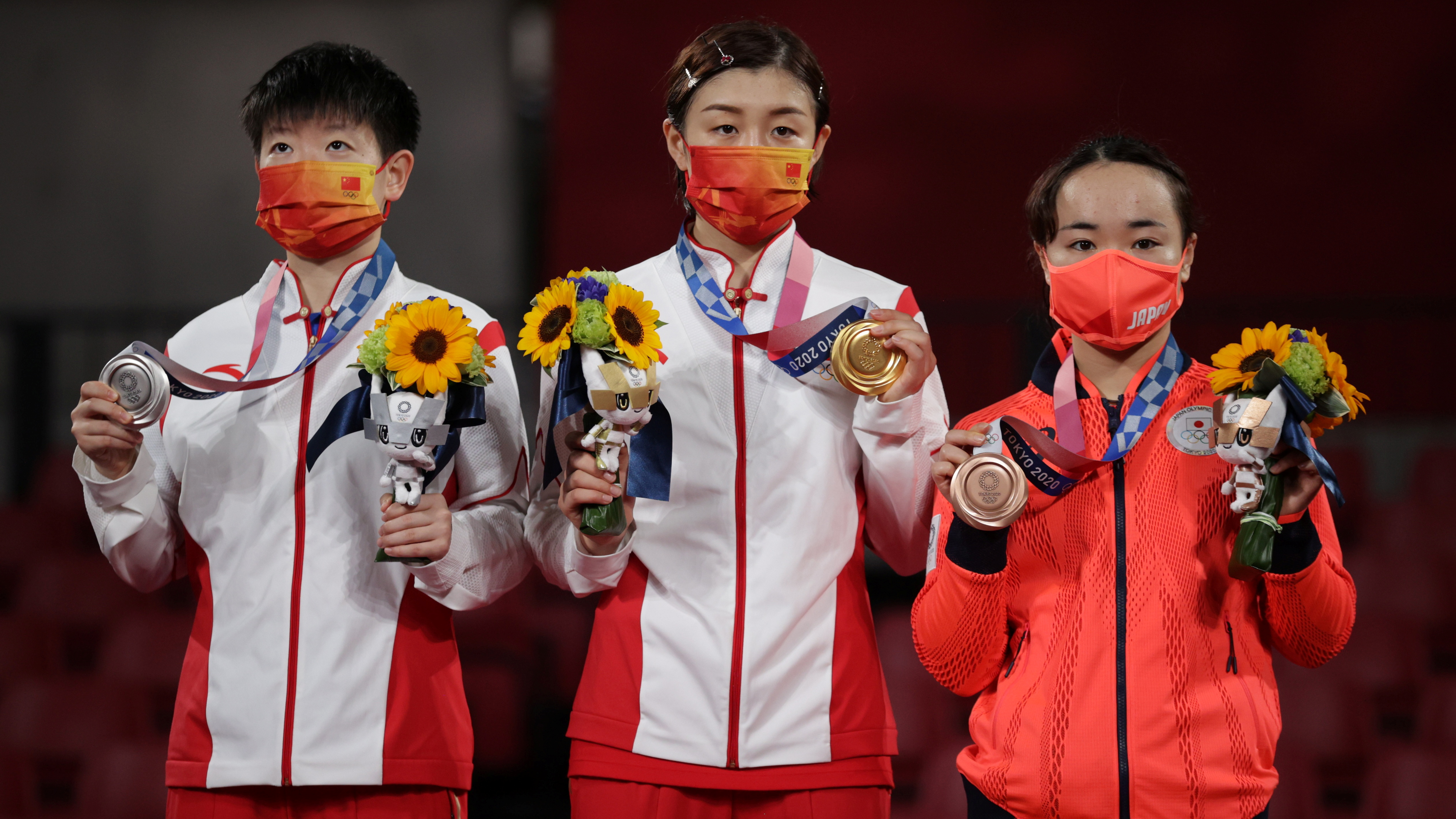 Tokyo 2020 Olympics - Table Tennis - Women's Singles - Medal Ceremony - Tokyo Metropolitan Gymnasium - Tokyo, Japan - July 29, 2021. Gold medalist Chen Meng of China, Silver medalist Sun Yingsha of China, and Bronze medalist Mima Ito of Japan, with their medals REUTERS/Hannah Mckay