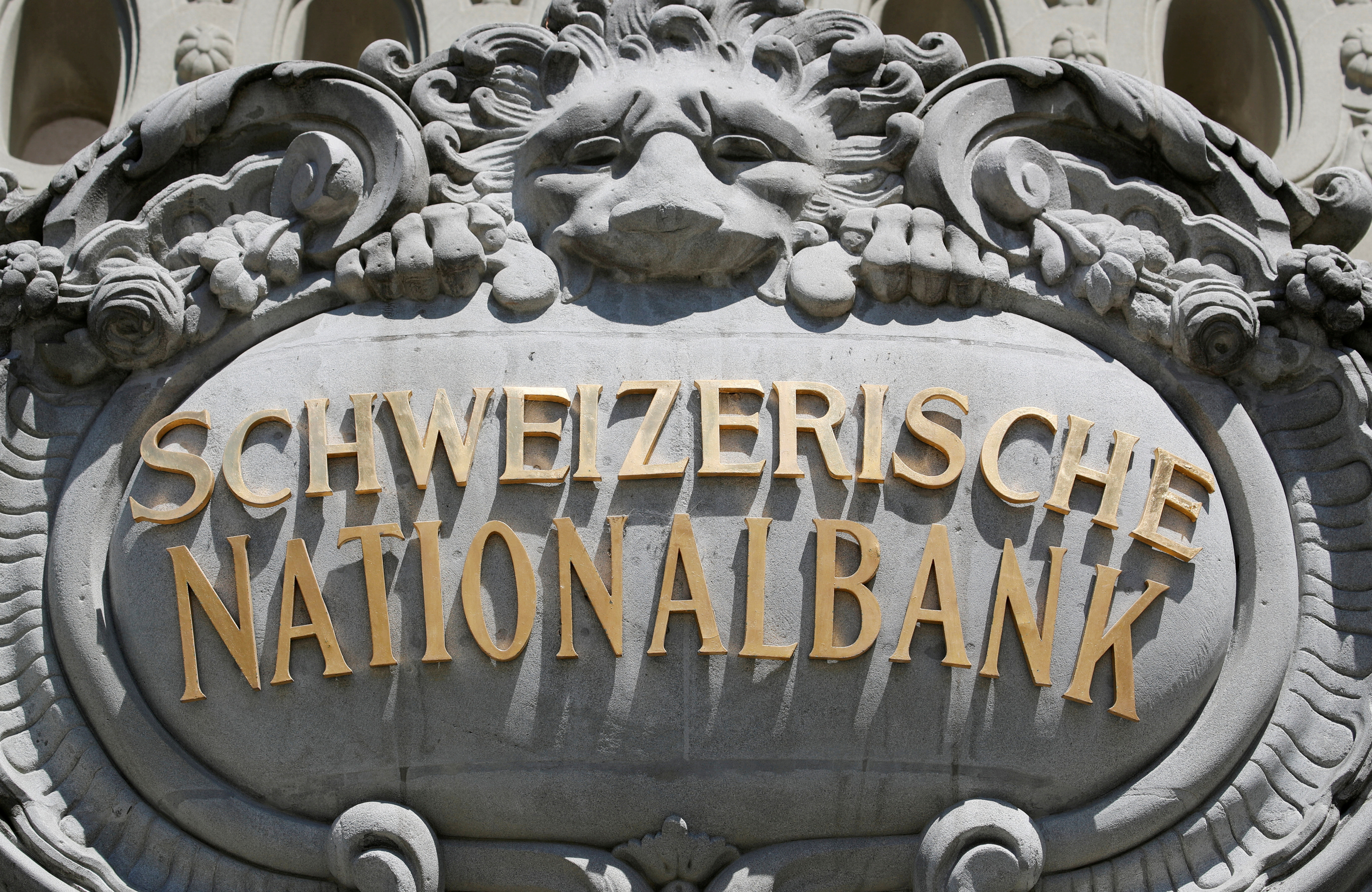 A Swiss National Bank logo is pictured on the SNB building in Bern, Switzerland May 20, 2020. Picture taken May 20, 2020. REUTERS/Arnd Wiegmann