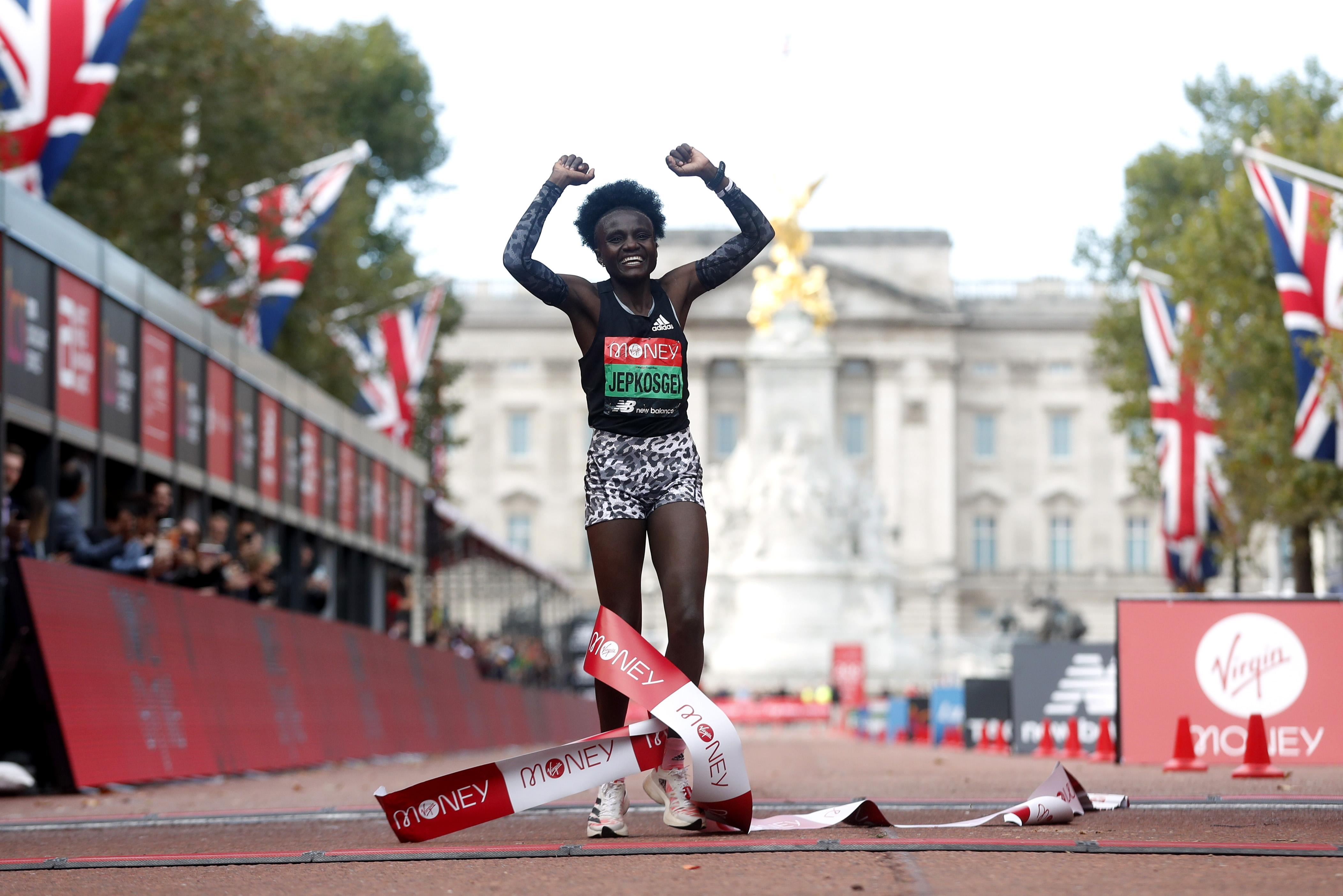 Athletics - London Marathon - London, Britain - October 3, 2021 Kenya's Joyciline Jepkosgei celebrates winning the elite women's race REUTERS/Matthew Childs
