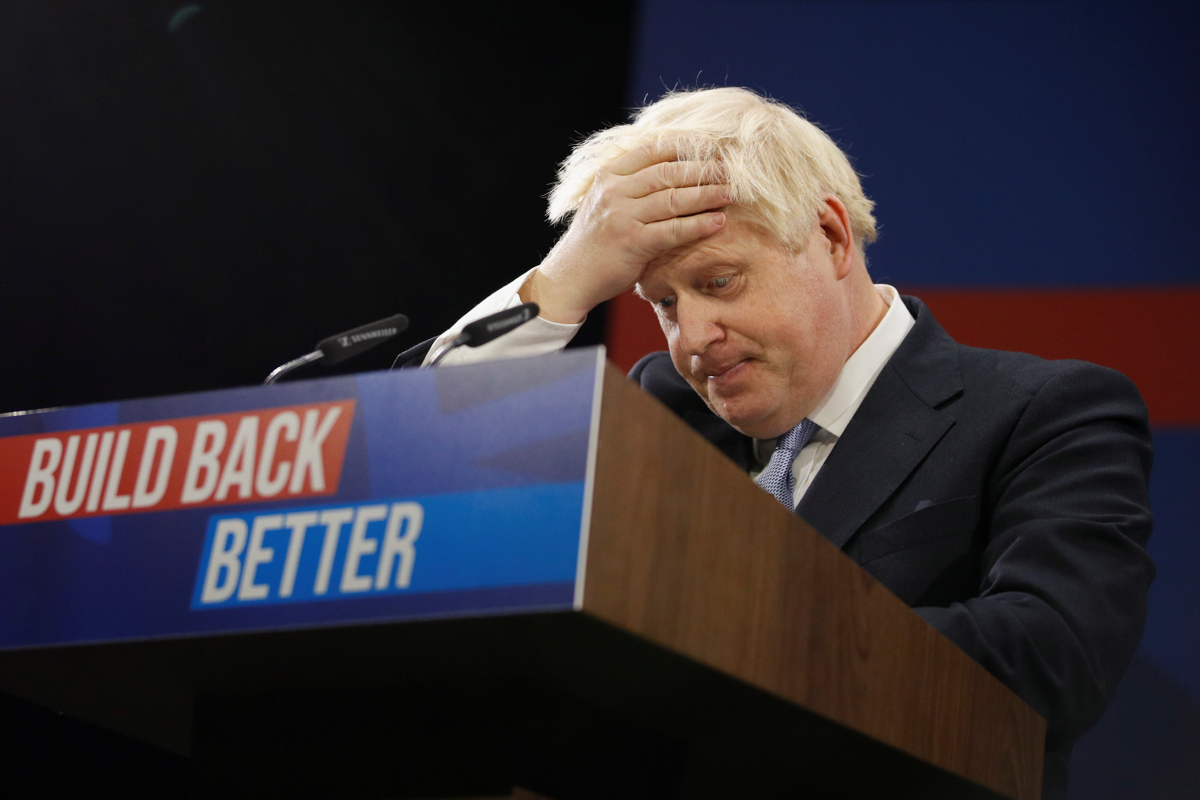 British Prime Minister Boris Johnson reacts as he delivers a speech in Manchester, Britain, October 6, 2021. REUTERS/Phil Noble