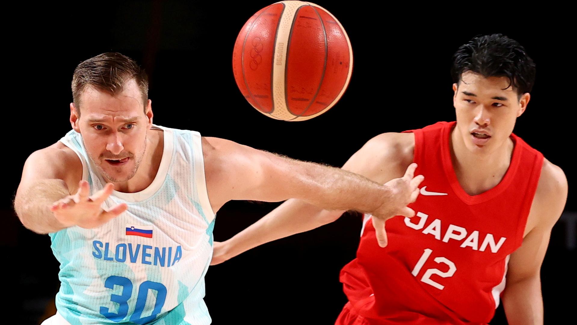 Tokyo 2020 Olympics - Basketball - Men - Group C - Slovenia v Japan - Saitama Super Arena, Saitama, Japan - July 29, 2021. Zoran Dragic of Slovenia in action with Y. Watanabe of Japan REUTERS/Alkis Konstantinidis