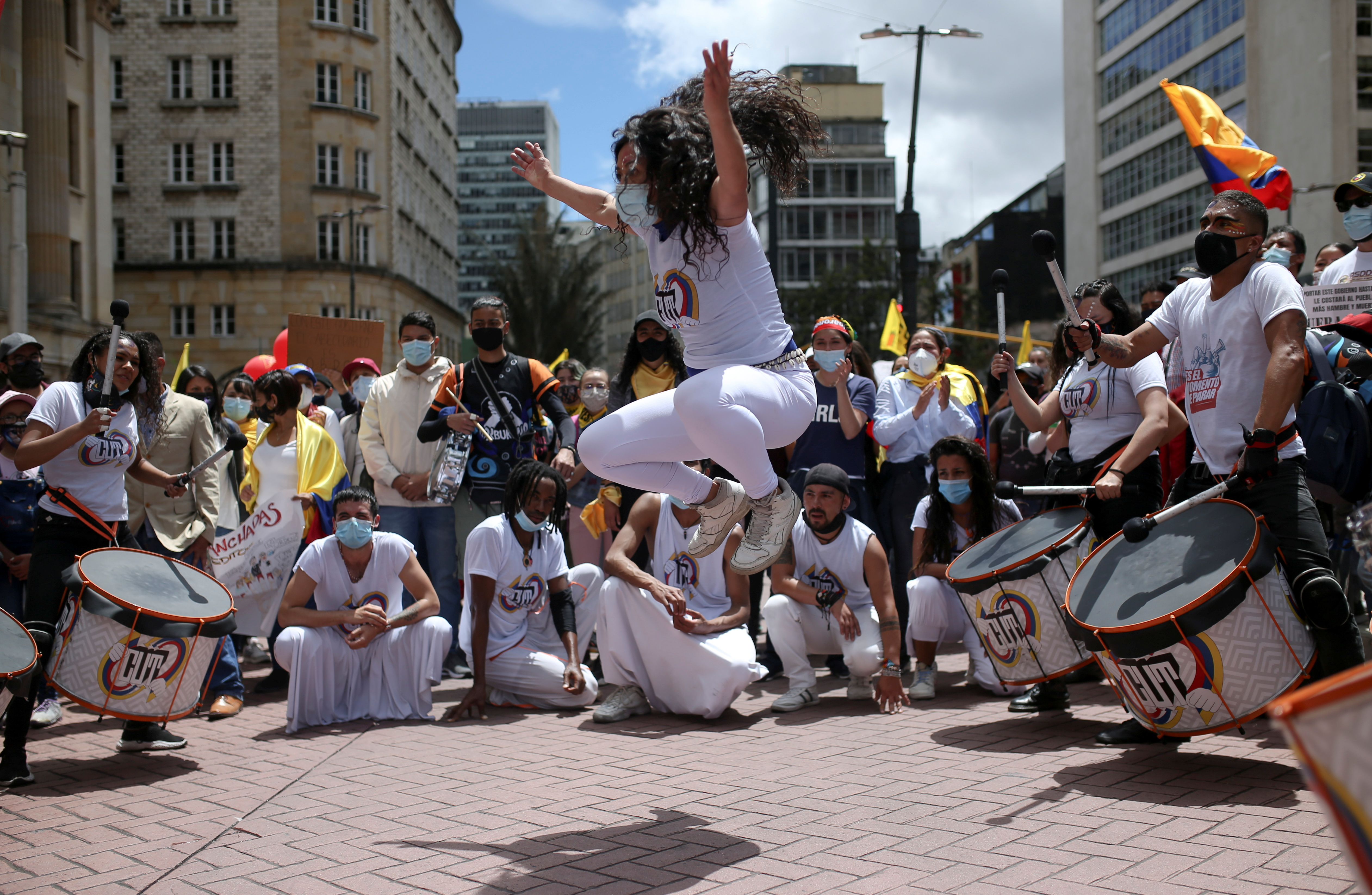 A woman dances as people play drums during a protest demanding government action to tackle poverty, police violence and inequalities in healthcare and education systems, in Bogota, Colombia May 26, 2021. REUTERS/Luisa Gonzalez