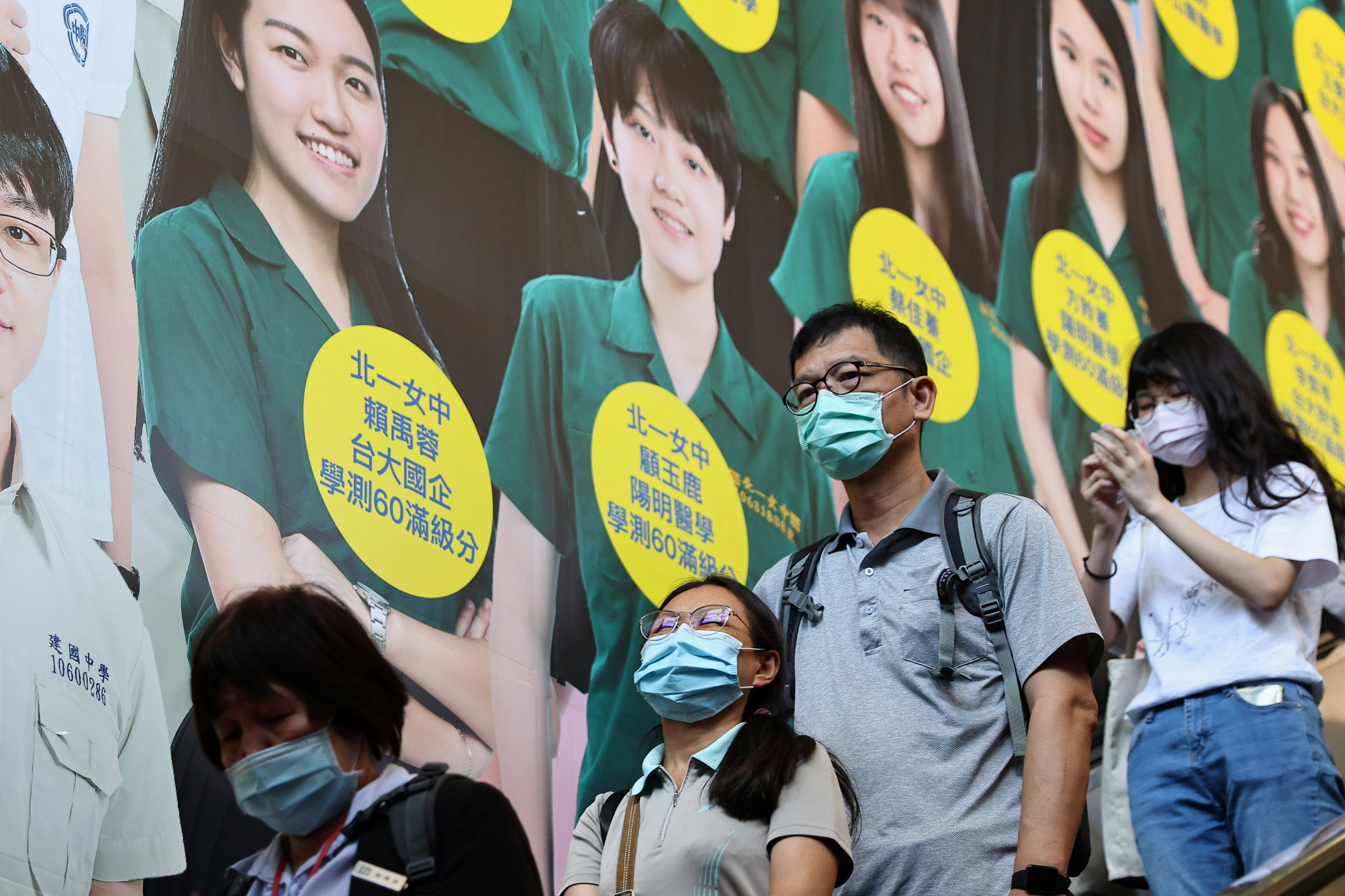 People wear protective face masks while heading in a metro station following the outbreak of  coronavirus disease (COVID-19), in Taipei, Taiwan, May 12, 2021. REUTERS/Ann Wang