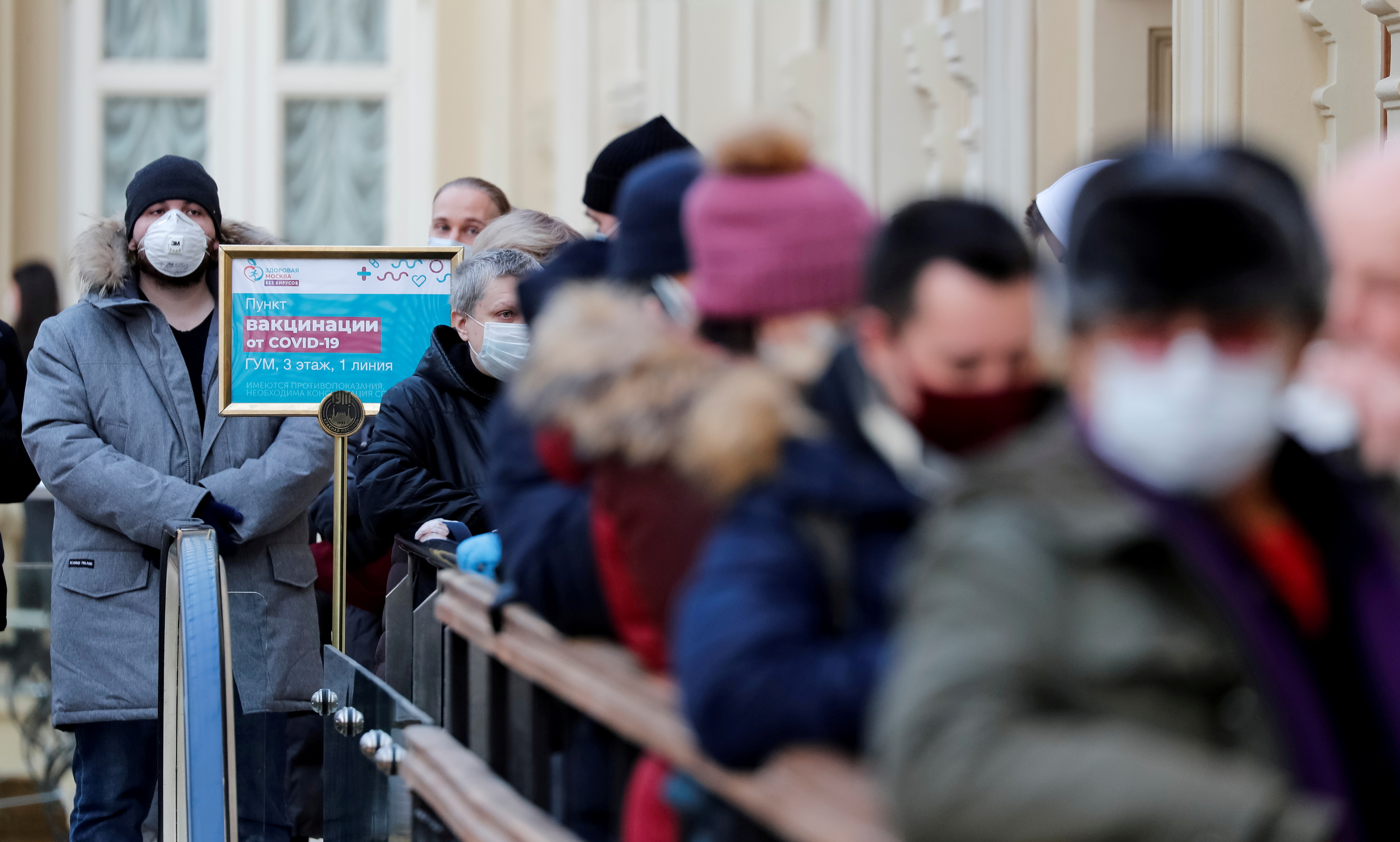 Peoplelineup to receive a dose of Sputnik V (Gam-COVID-Vac) vaccine against the coronavirus disease (COVID-19) at a vaccination centre in the State Department Store, GUM, in central Moscow, Russia January 18, 2021. REUTERS/Shamil Zhumatov