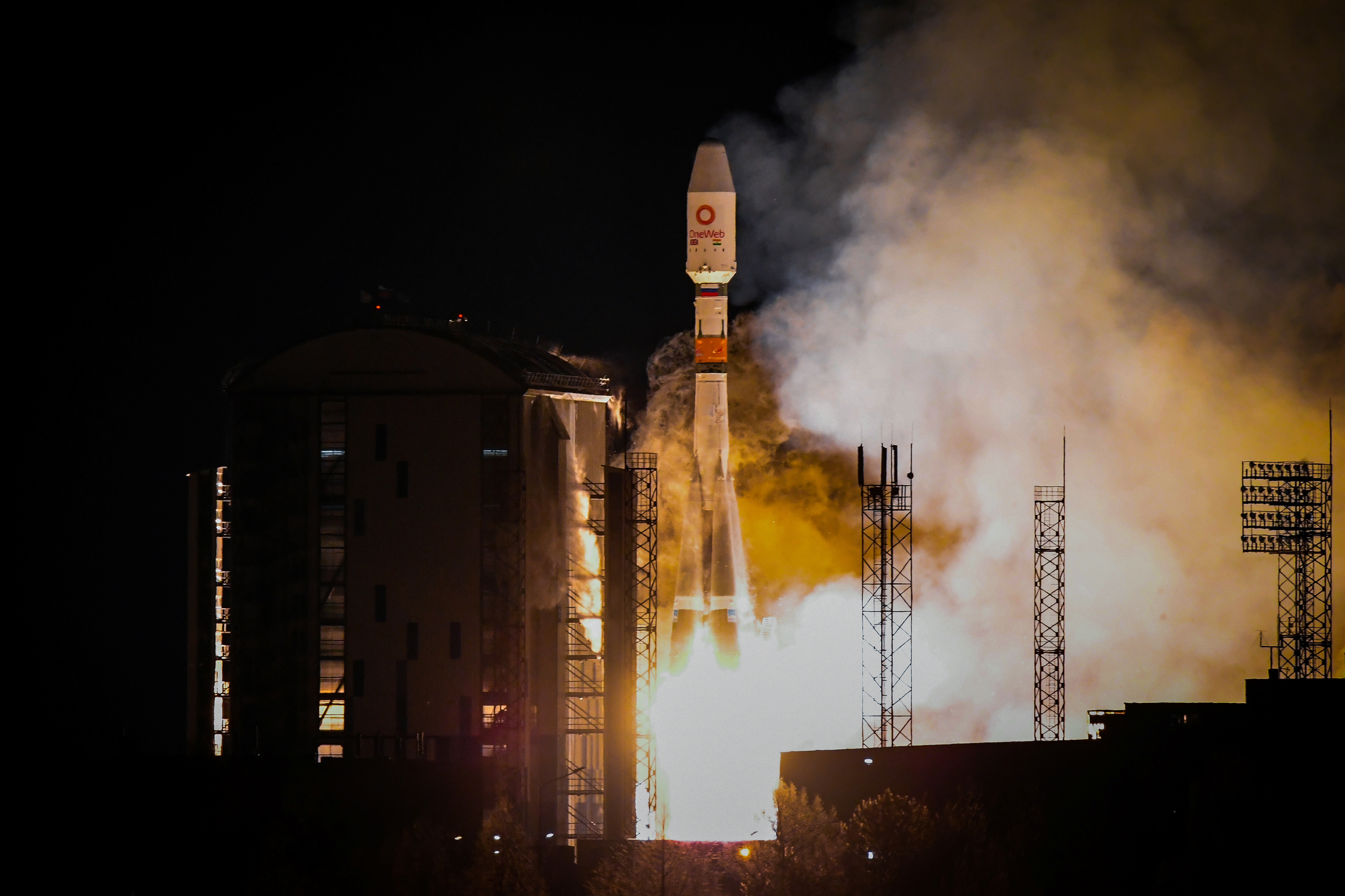 A Soyuz-2.1b rocket booster carrying the satellites of British firm OneWeb blasts off from a launch pad at the Vostochny Cosmodrome in Amur Region, Russia December 18, 2020. Russian space agency Roscosmos/Handout via REUTERS