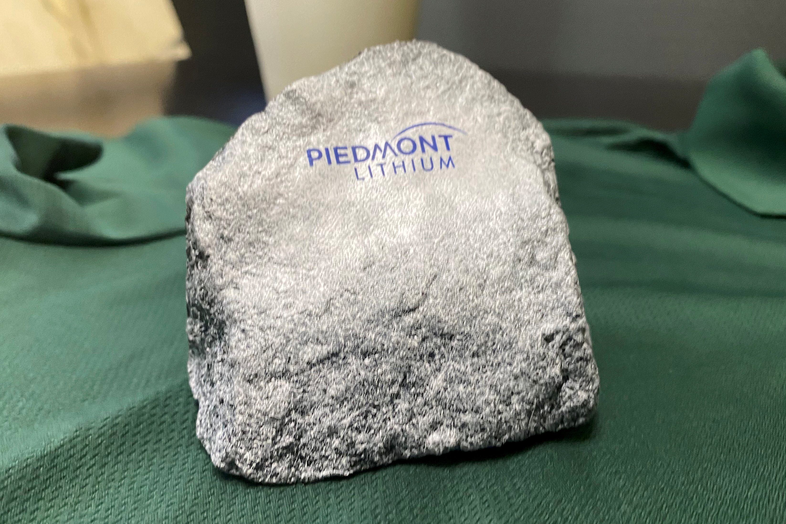 A rock stamped with a logo is displayed at Piedmont Lithium's headquarters in Belmont, Gaston County, North Carolina, U.S., July 16, 2021. REUTERS/Ernest Scheyder/Files