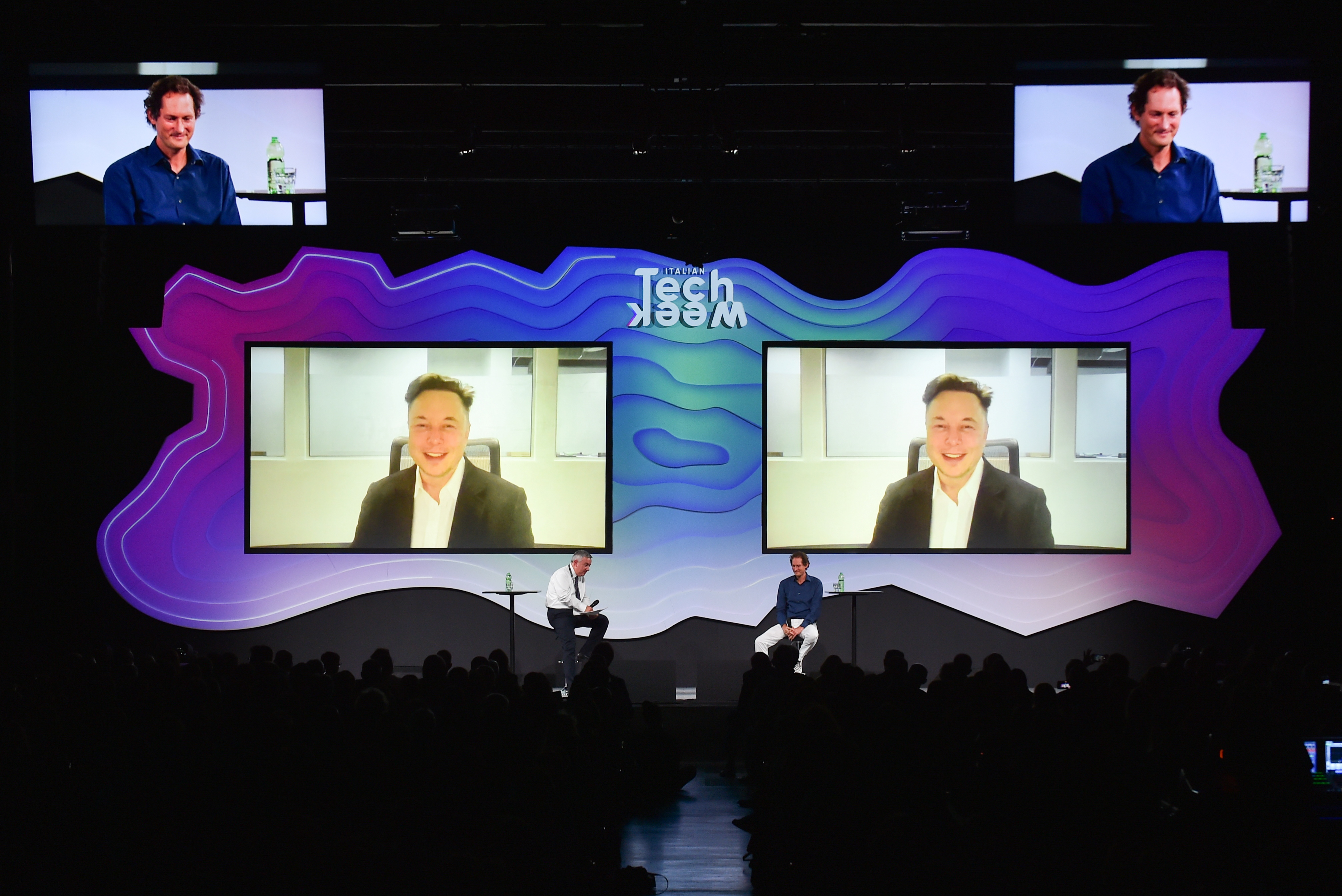 """Chairman of Stellantis and Ferrari John Elkann speaks via video conference with Tesla's founder Elon Musk during the """"Italian Tech Week"""" event in Turin, Italy September 24, 2021. REUTERS/Massimo Pinca"""