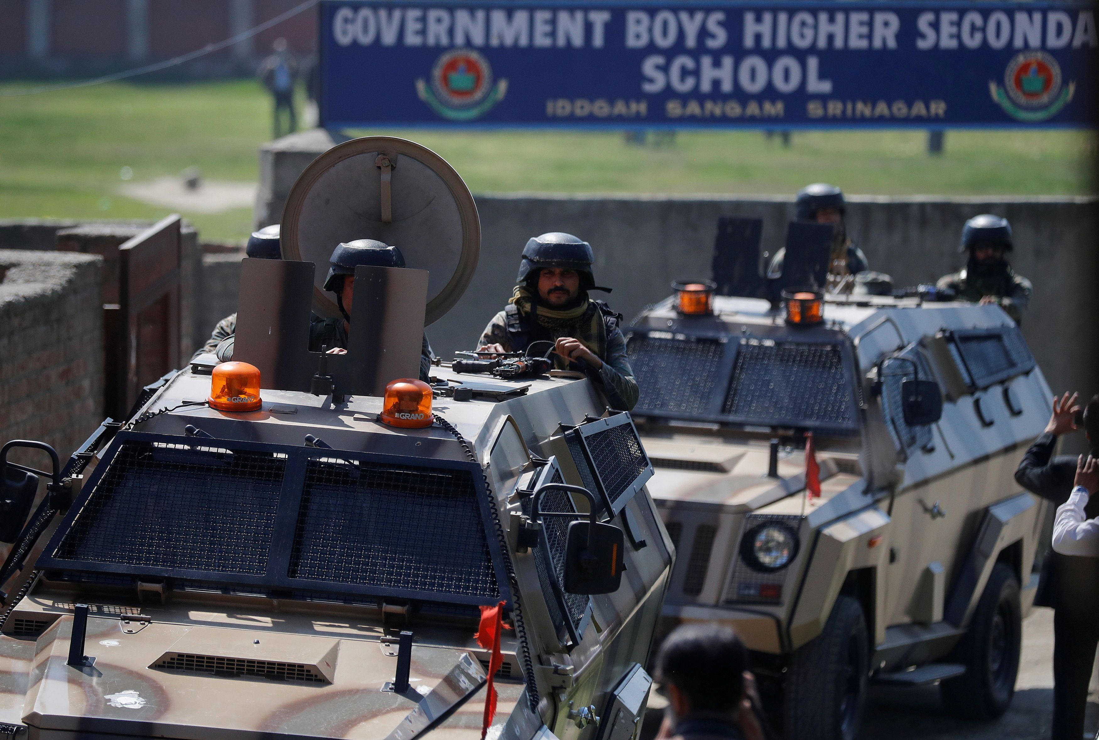 Indian security forces keep guard atop armoured vehicles, outside a government school after suspected militants shot and killed two teachers in Srinagar, October 7, 2021. REUTERS/Danish Ismail/File Photo