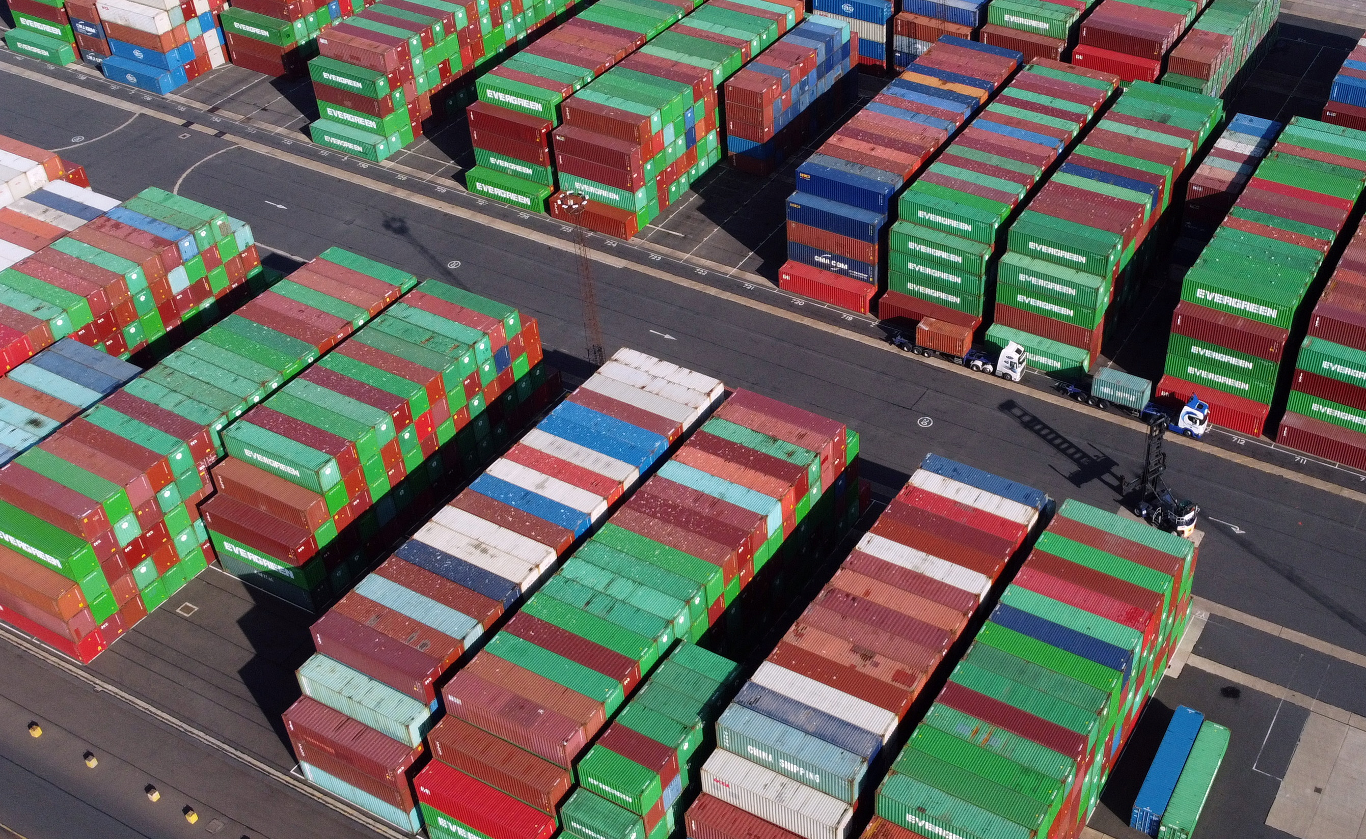 A view shows stacked shipping containers at the port of Felixstowe, Britain, October 13, 2021.   REUTERS/Hannah McKay