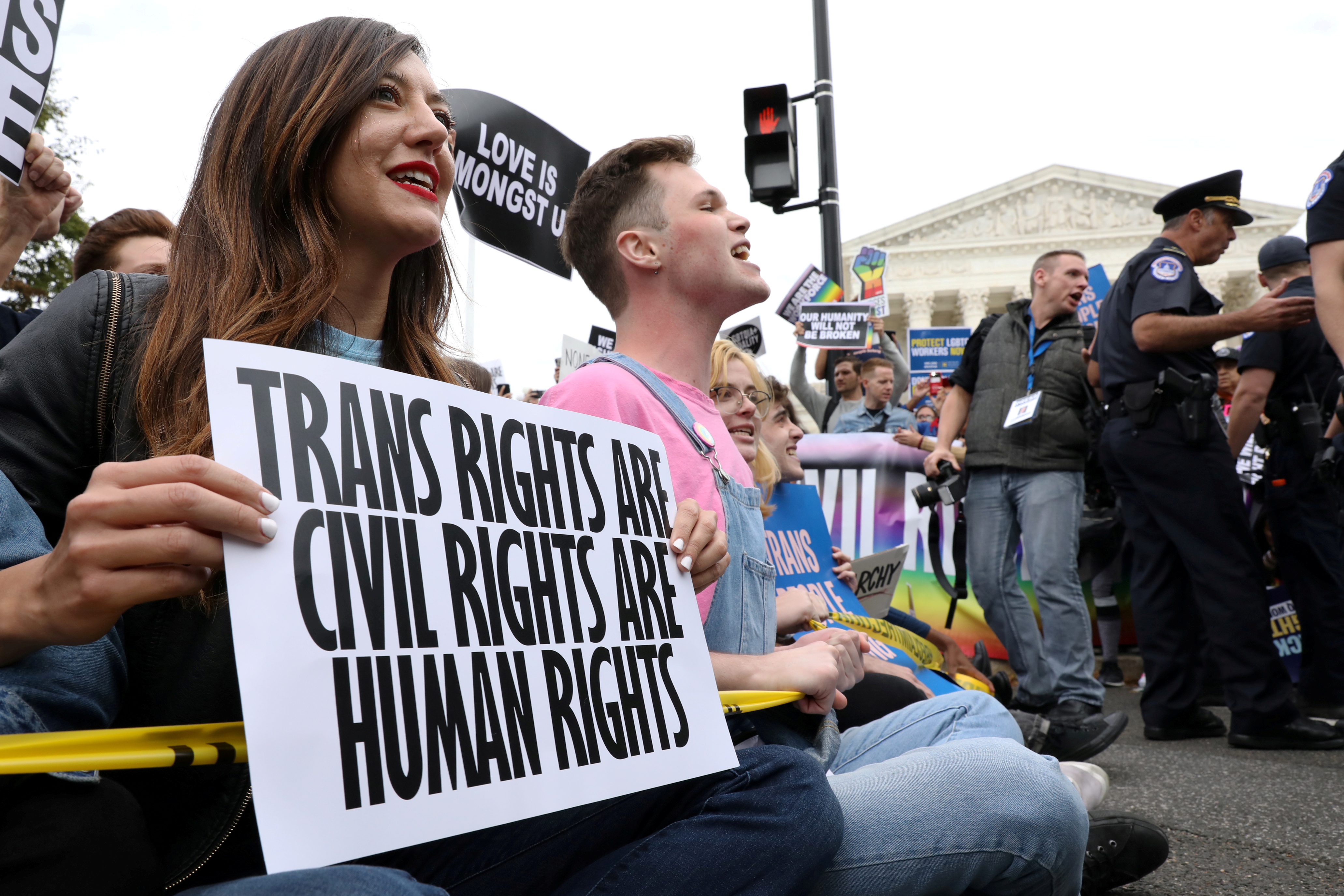 LGBTQ activists and supporters block the street outside the U.S. Supreme Court as it hears arguments in a major LGBT rights case on whether a federal anti-discrimination law that prohibits workplace discrimination on the basis of sex covers gay and transgender employees in Washington, U.S. October 8, 2019.  REUTERS/Jonathan Ernst