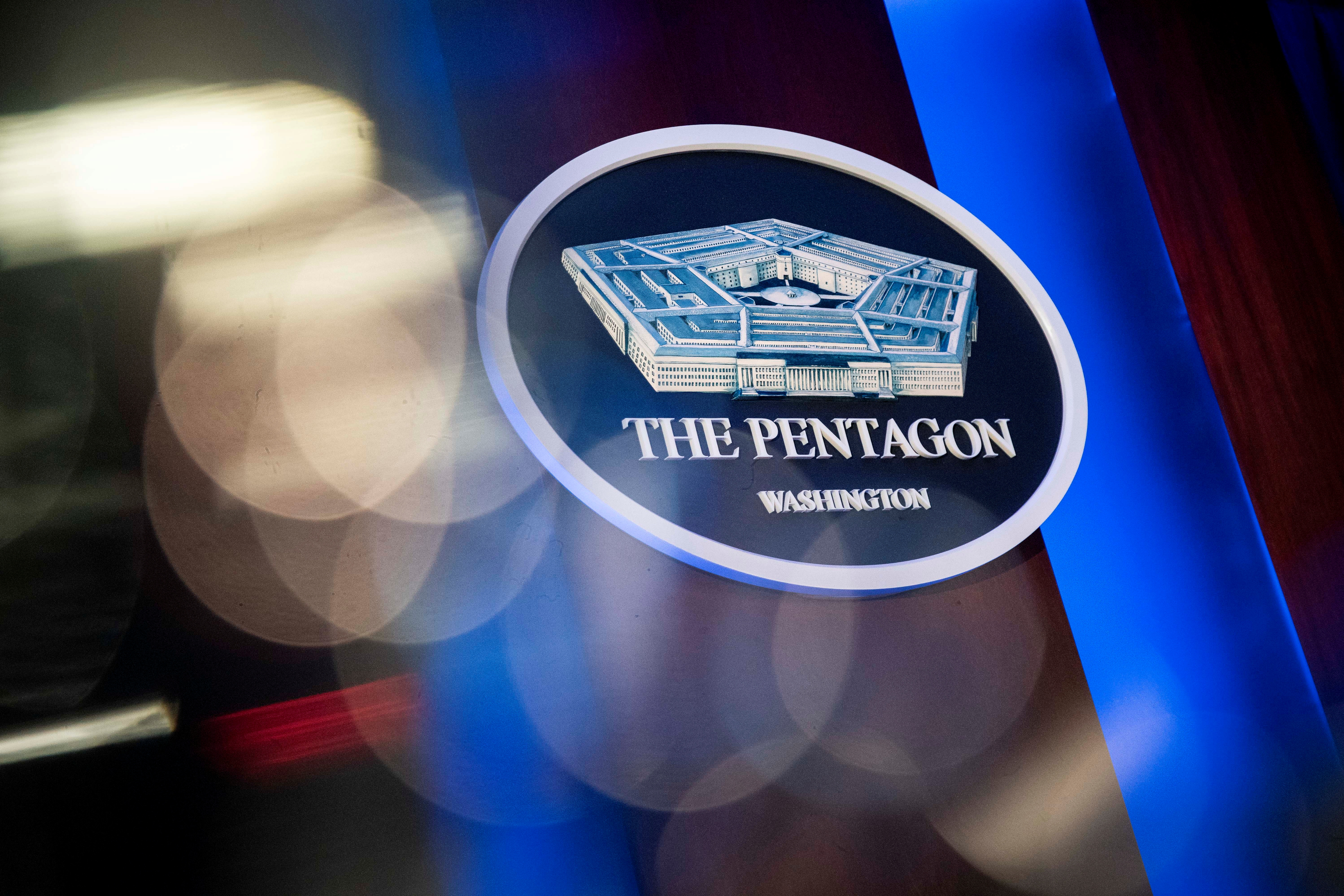 The Pentagon logo is seen behind the podium in the briefing room at the Pentagon in Arlington, Virginia, U.S., January 8, 2020. REUTERS/Al Drago/File Photo