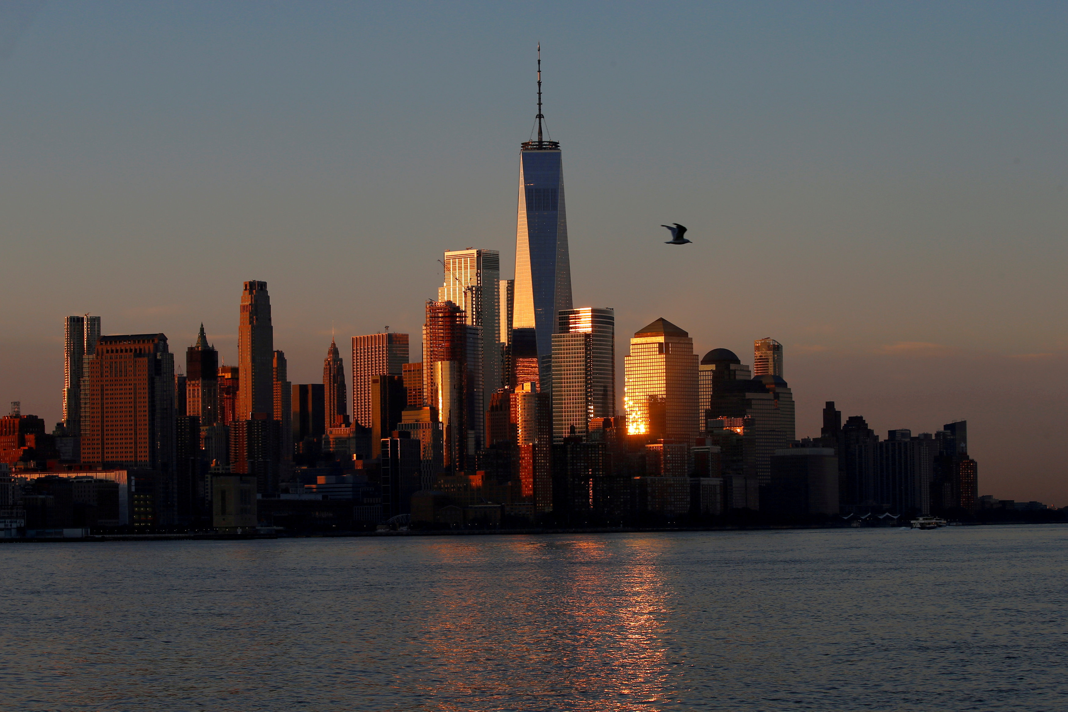 A view of the One World Trade Centre tower and the lower Manhattan skyline of New York City at sunrise as seen from Hoboken, New Jersey, U.S., August 9, 2017. REUTERS/Mike Segar