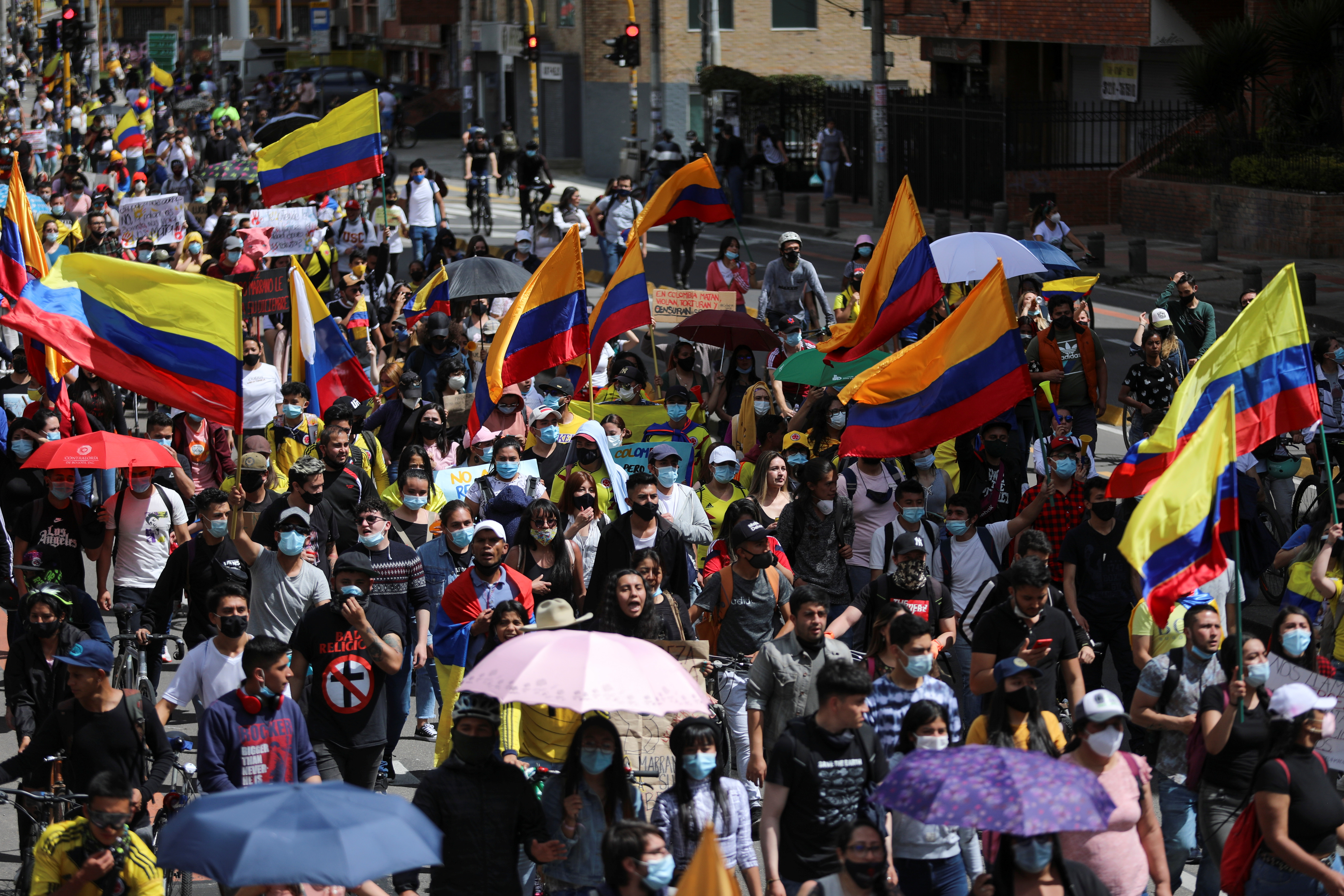 Demonstrators take part in a protest demanding government action to tackle poverty, police violence and inequalities in healthcare and education systems, in Bogota, Colombia, May 9, 2021.  REUTERS/Luisa Gonzalez