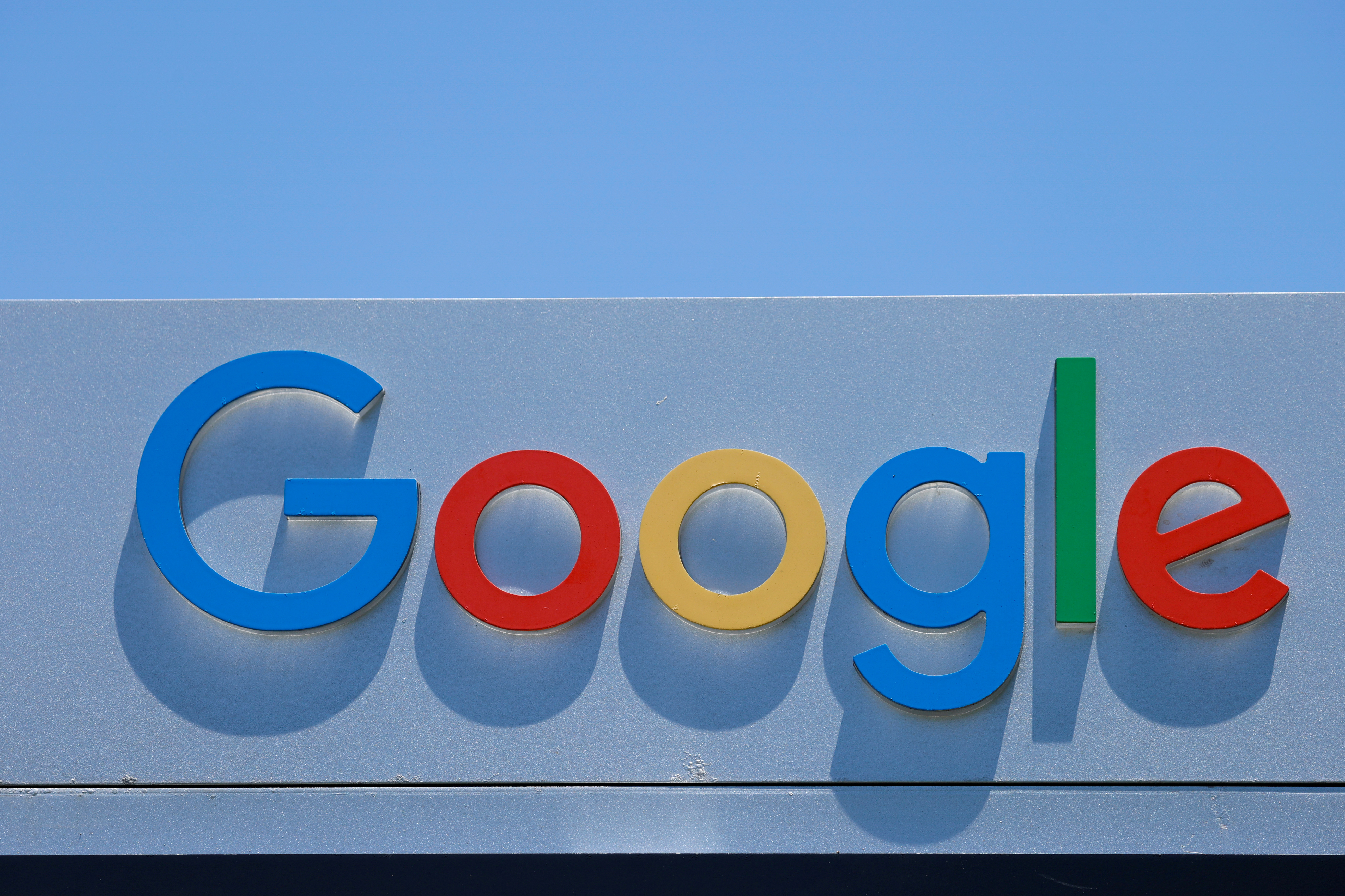 After the company announced it would extend its coronavirus work-from-home order until summer 2021, a Google sign is shown at one of the company's office complexes in Irvine, California, U.S., July 27, 2020. REUTERS/Mike Blake