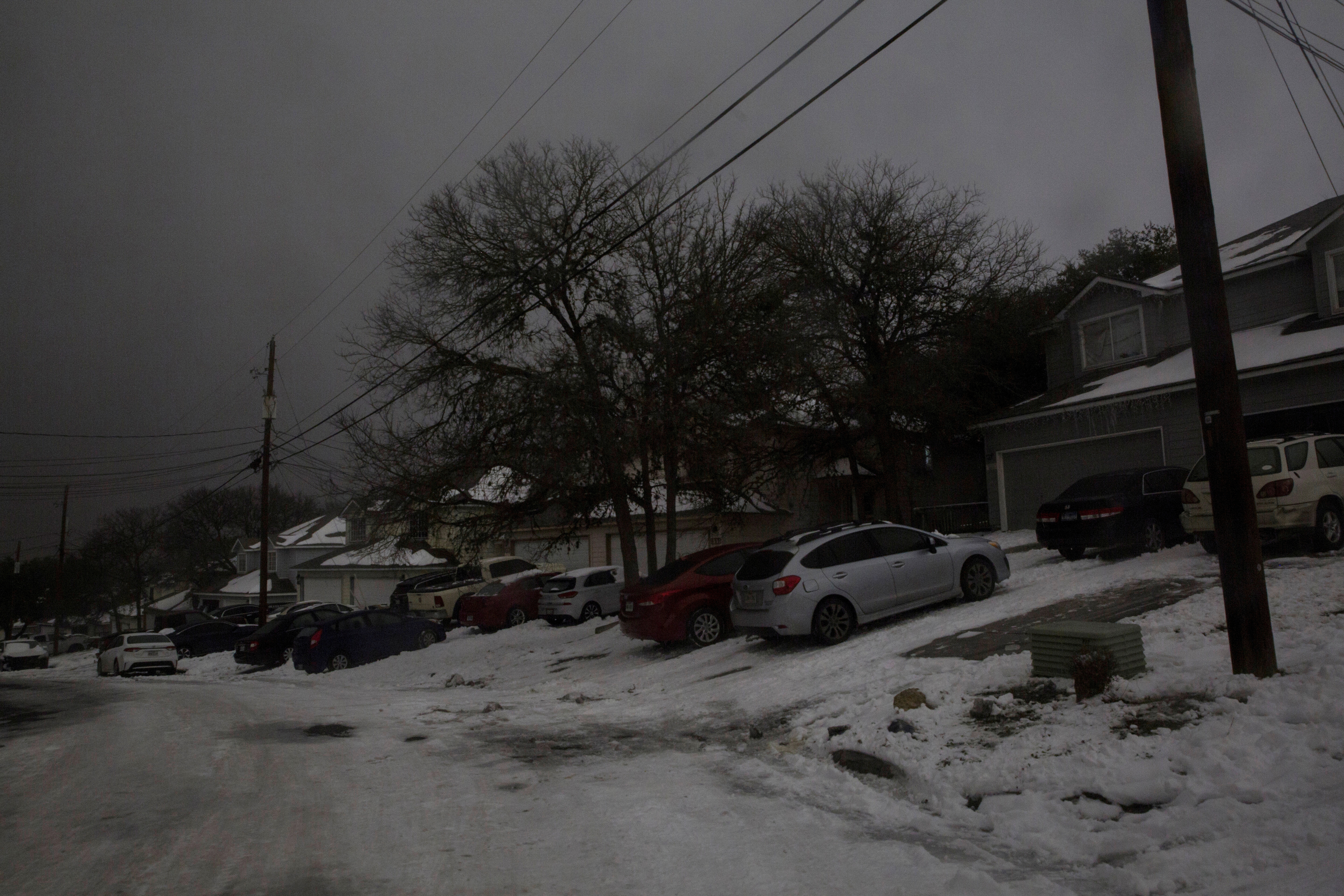 A neighborhood experiences a power outage after winter weather caused electricity blackouts in San Marcos, Texas, U.S. February 16, 2021. Picture taken February 16, 2021. REUTERS/Mikala Compton
