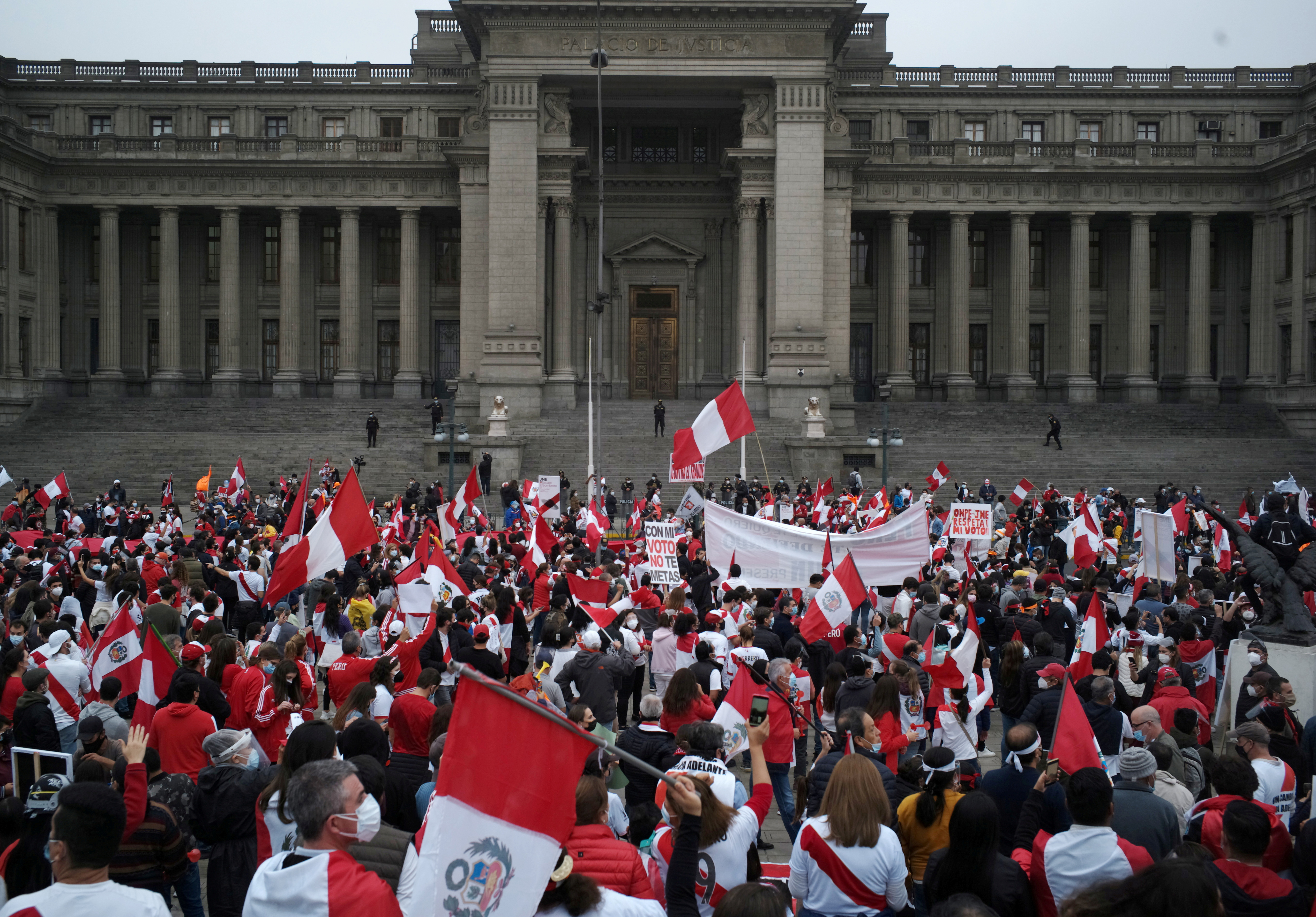 Supporters of Peru's presidential candidate Keiko Fujimori gather outside the Palace of Justice, the seat of Peru's Supreme Court, during a demonstration in Lima, Peru June 12, 2021.  REUTERS/Alessandro Cinque/File Photo