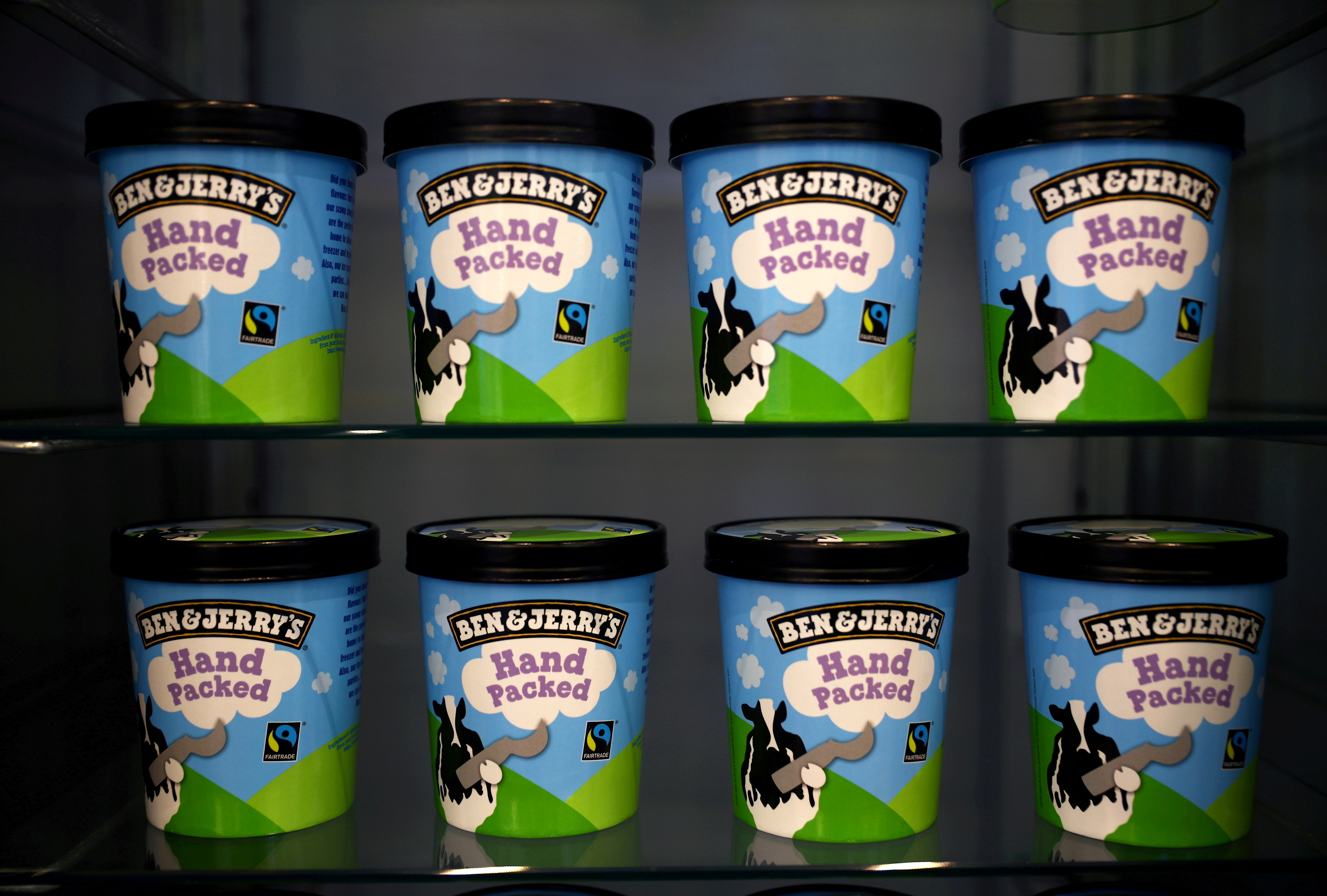 Tubs of Ben & Jerry's ice cream, a Unilever brand, are seen at their shop in London, Britain, October 5, 2020. REUTERS/Hannah McKay/File Photo