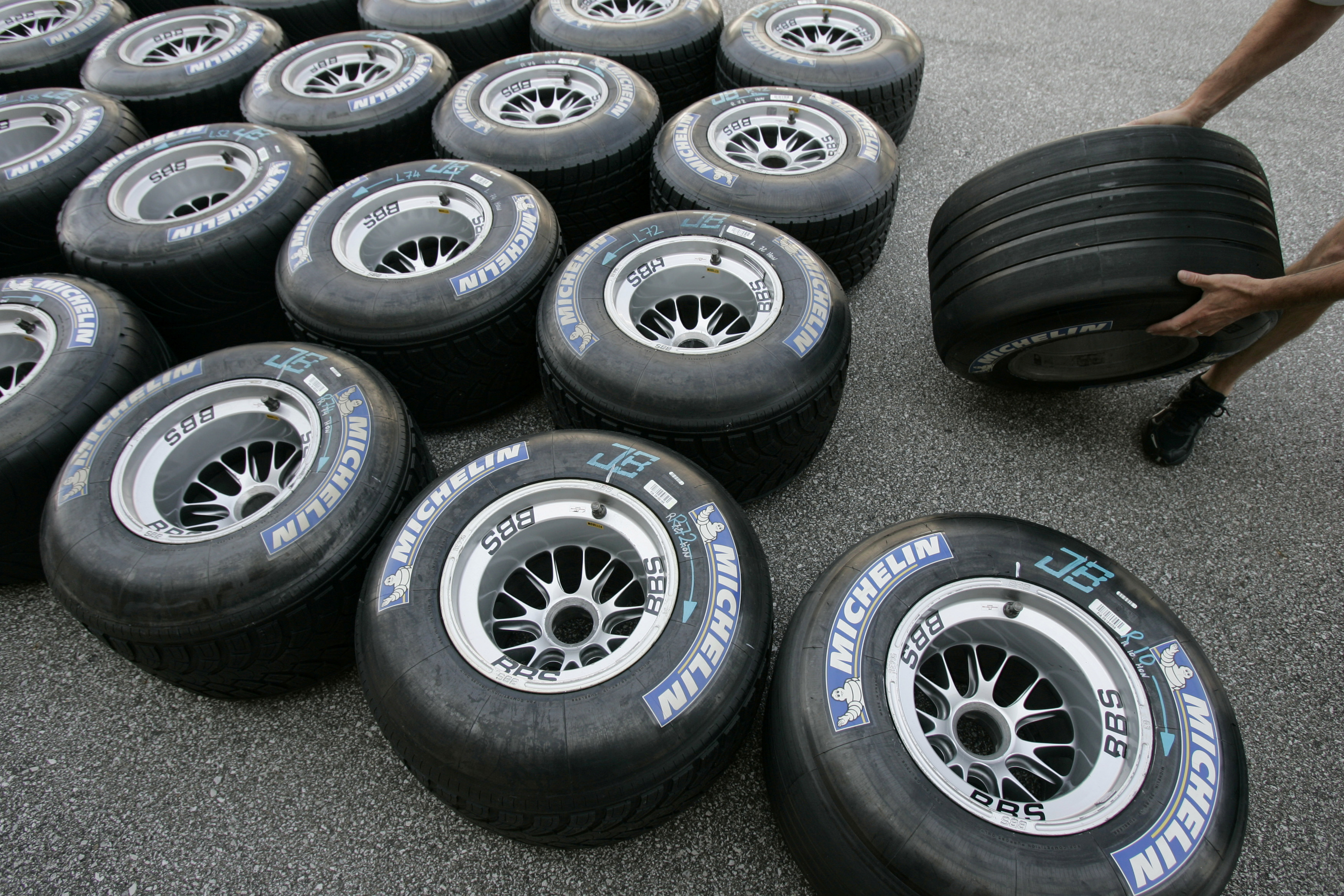 Michelin Formula One tires are prepared for racing in the pits at the Indianapolis Motor Speedway, June 29, 2006.   REUTERS/John Gress/File Photo