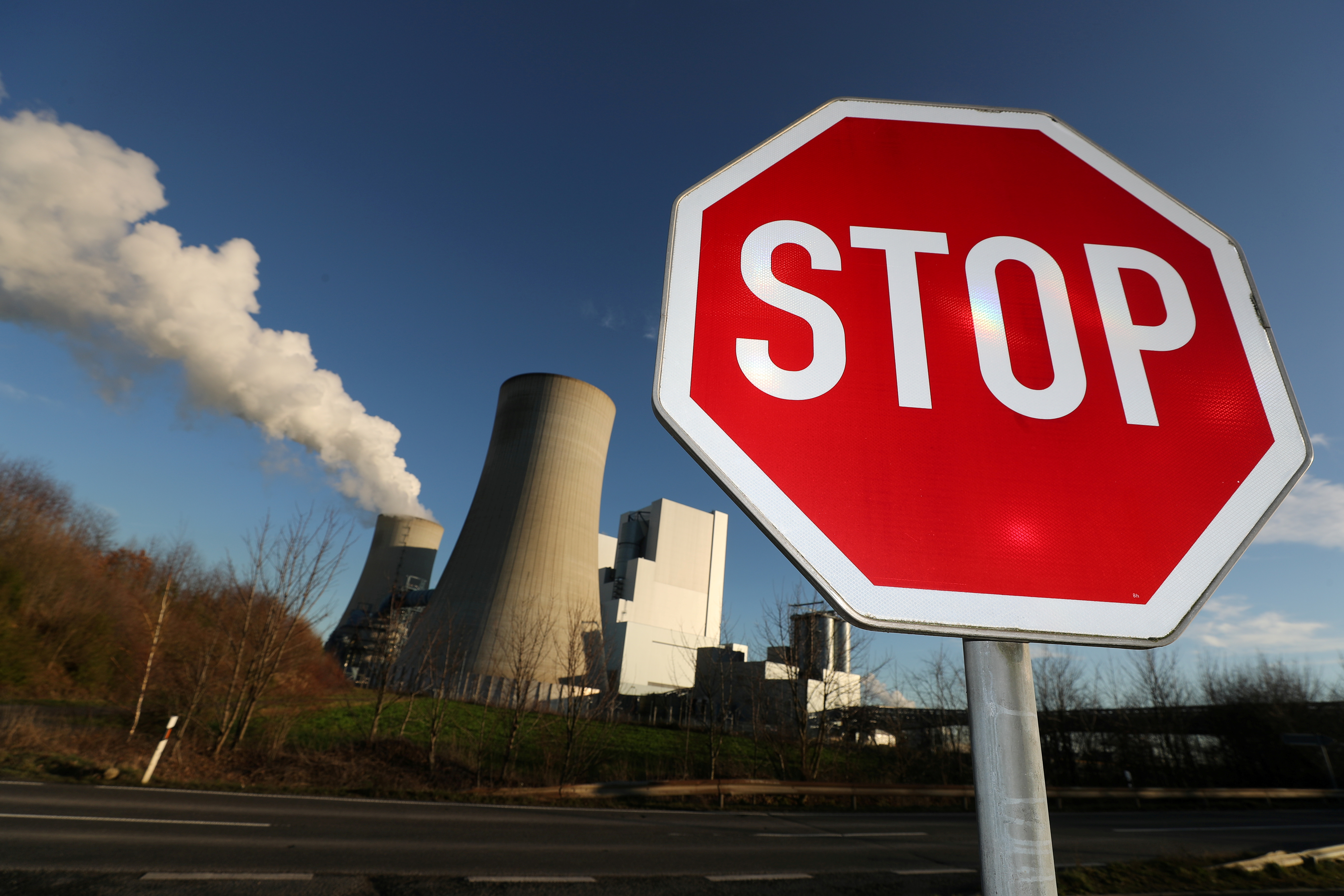 A Stop sign stands in front of the Neurath lignite power plant of German utility RWE, west of Cologne, Germany, January 16, 2020. REUTERS/Wolfgang Rattay/File Photo