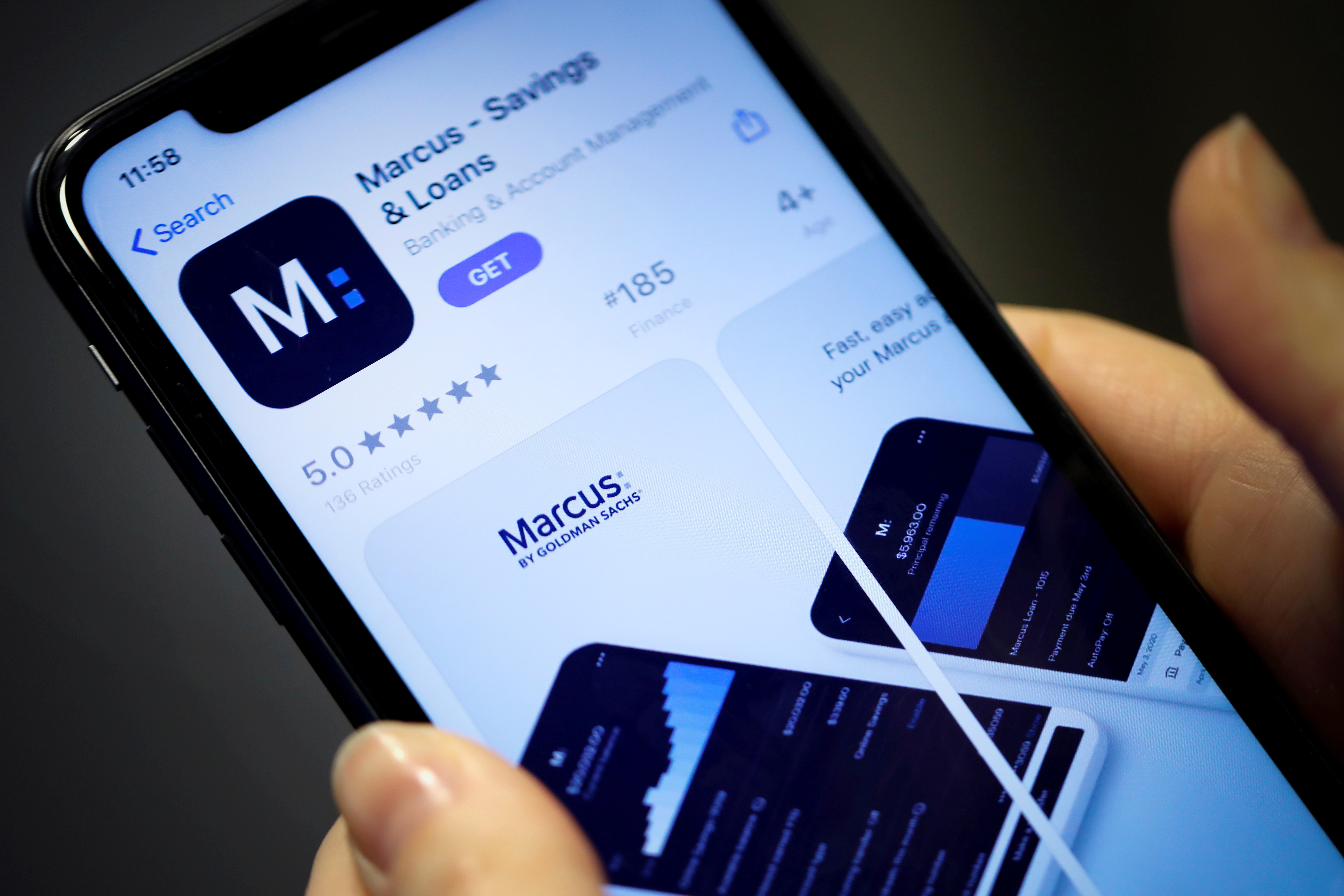 A woman looks at Marcus, a new savings and loans app recently launched by Goldman Sachs in New York, U.S., January 10, 2020. REUTERS/Mike Segar/File Photo