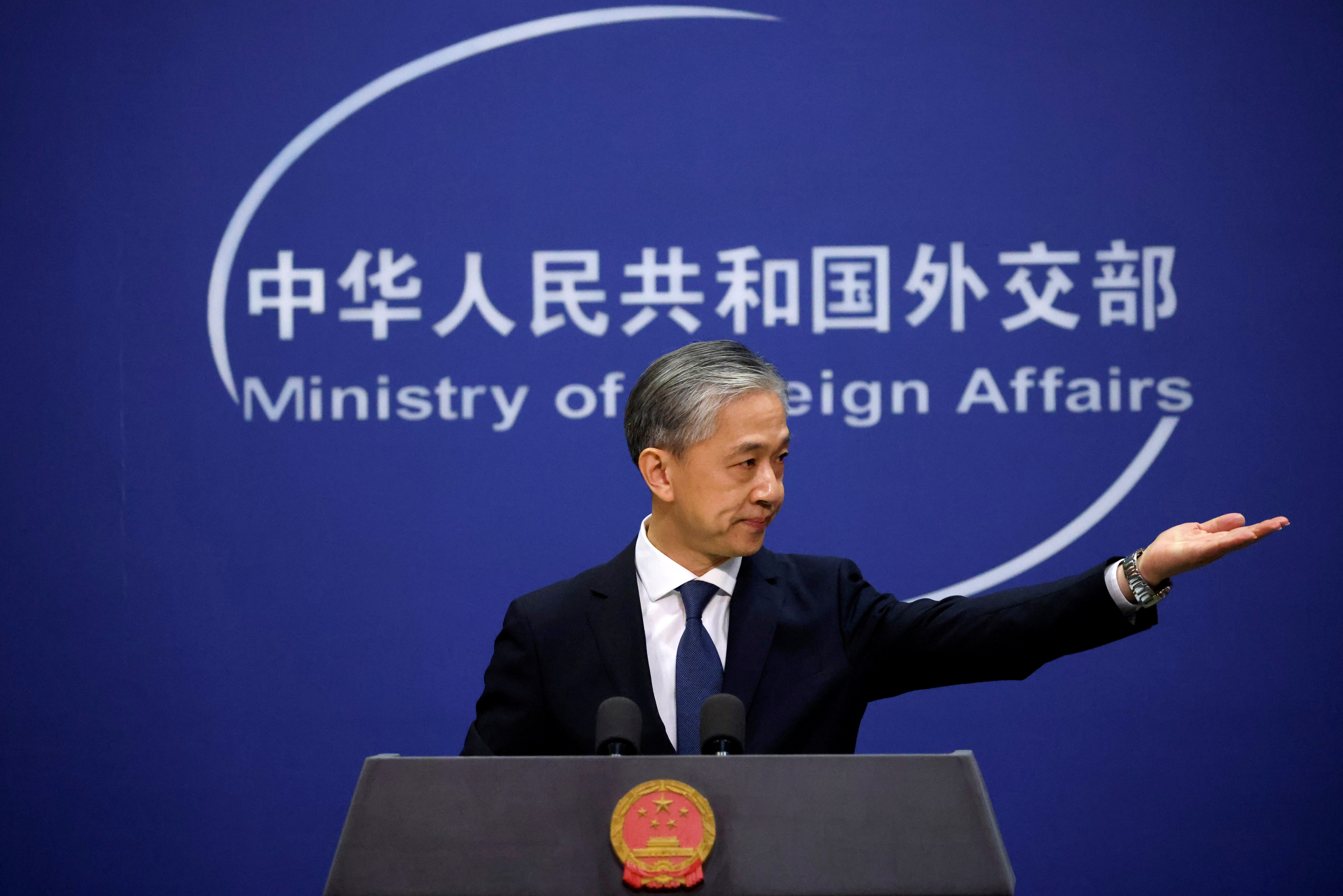 Chinese Foreign Ministry spokesman Wang Wenbin attends a news conference in Beijing, China December 14, 2020. REUTERS/Thomas Peter