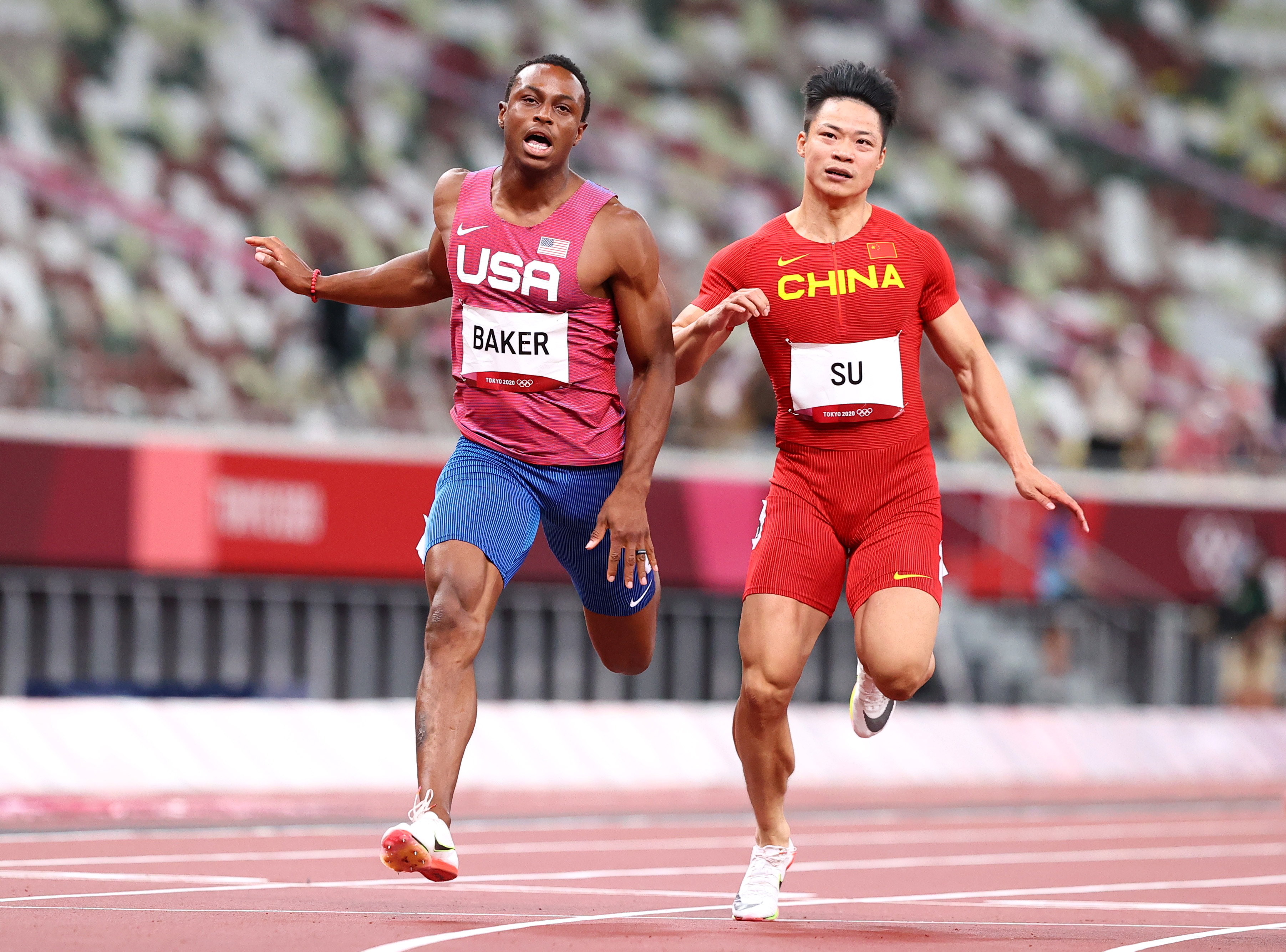 Tokyo 2020 Olympics - Athletics - Men's 100m - Final - OLS - Olympic Stadium, Tokyo, Japan - August 1, 2021. Su Bingtian of China and Ronnie Baker of United States in action REUTERS/Lucy Nicholson/File Photo