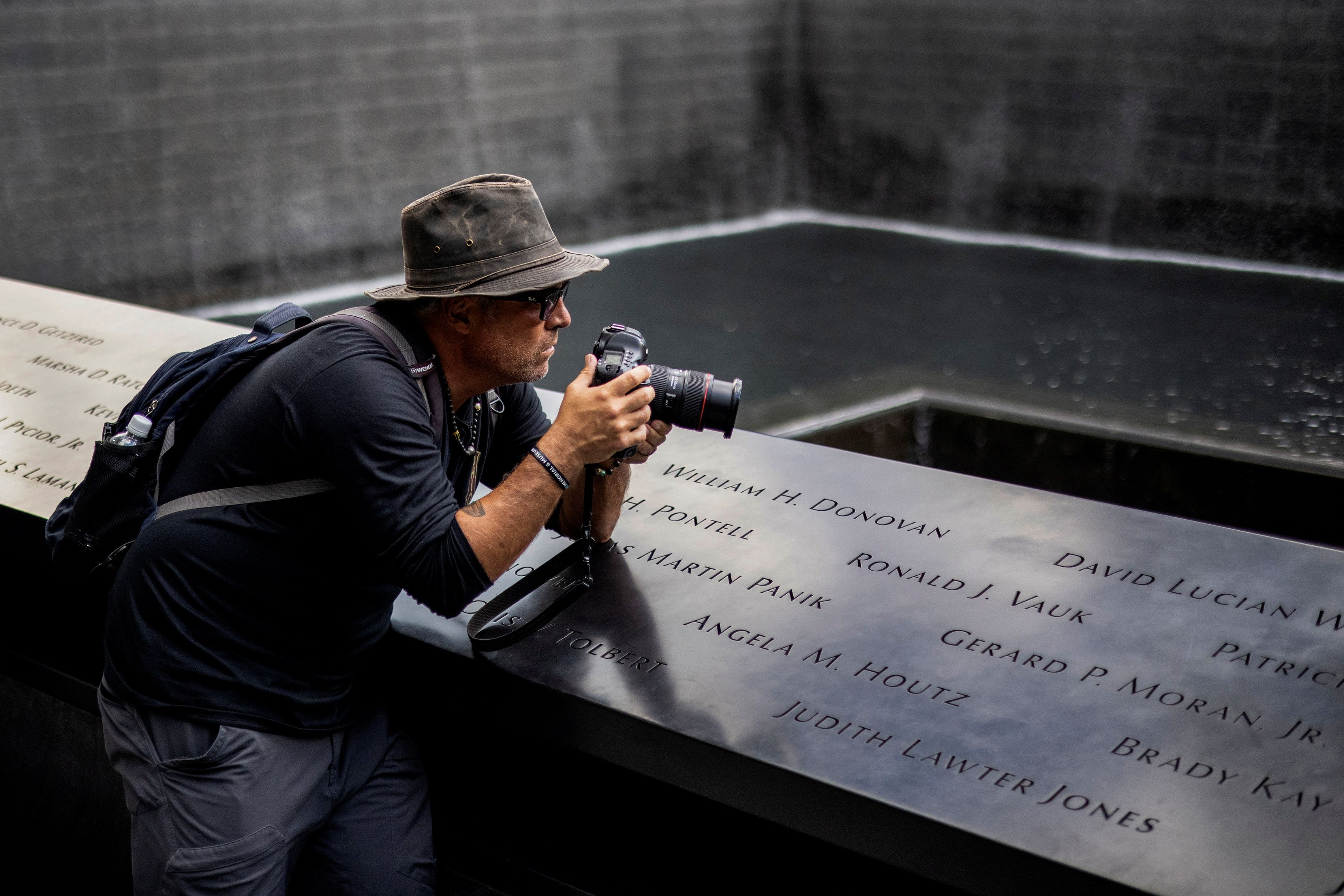 Shannon Stapleton takes photographs at the 9/11 Memorial site in Lower Manhattan, September 2, 2021. REUTERS/Carlos Barria