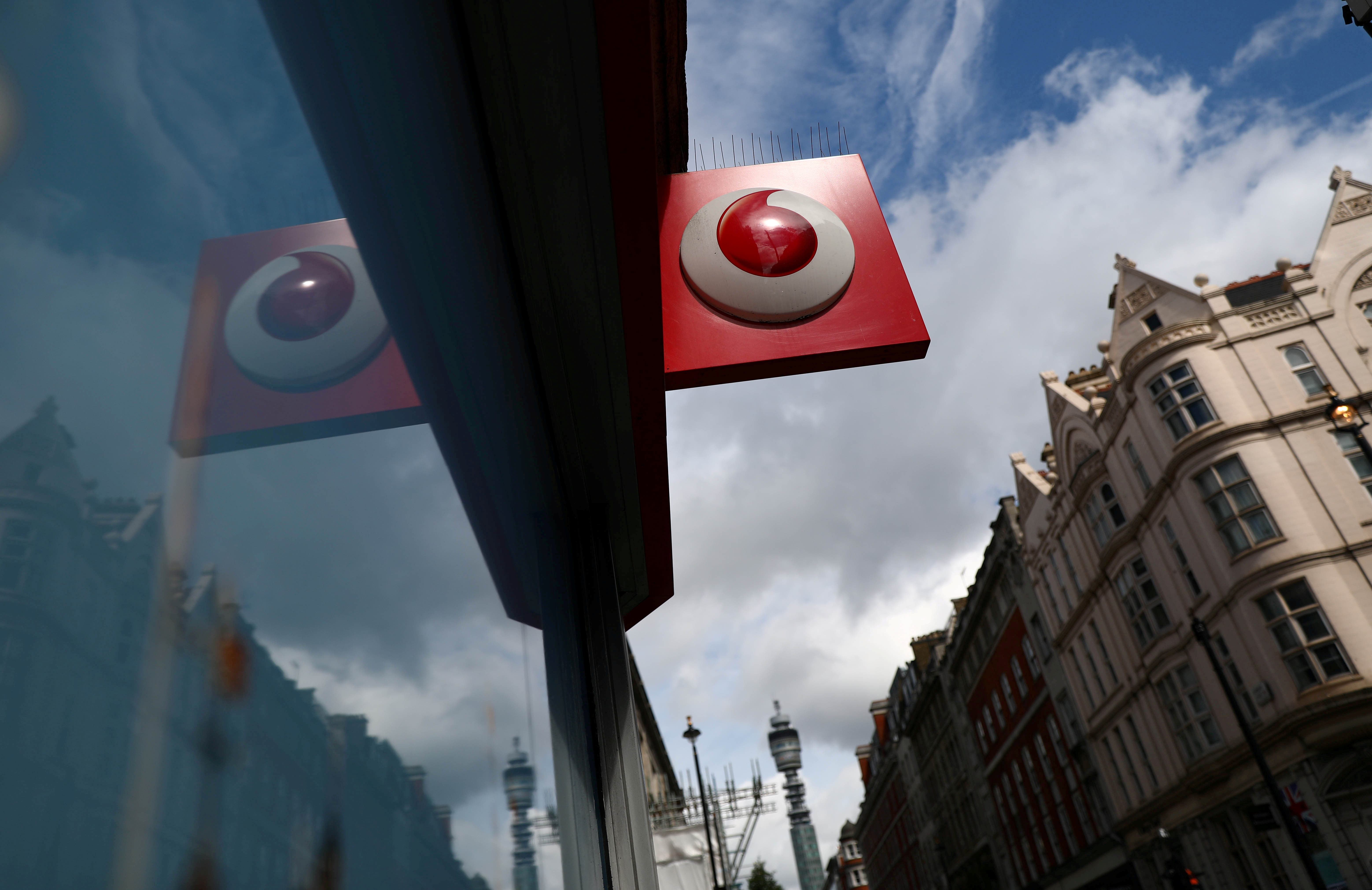 A branded sign is displayed on a Vodafone store in London, Britain May 16, 2017. REUTERS/Neil Hall