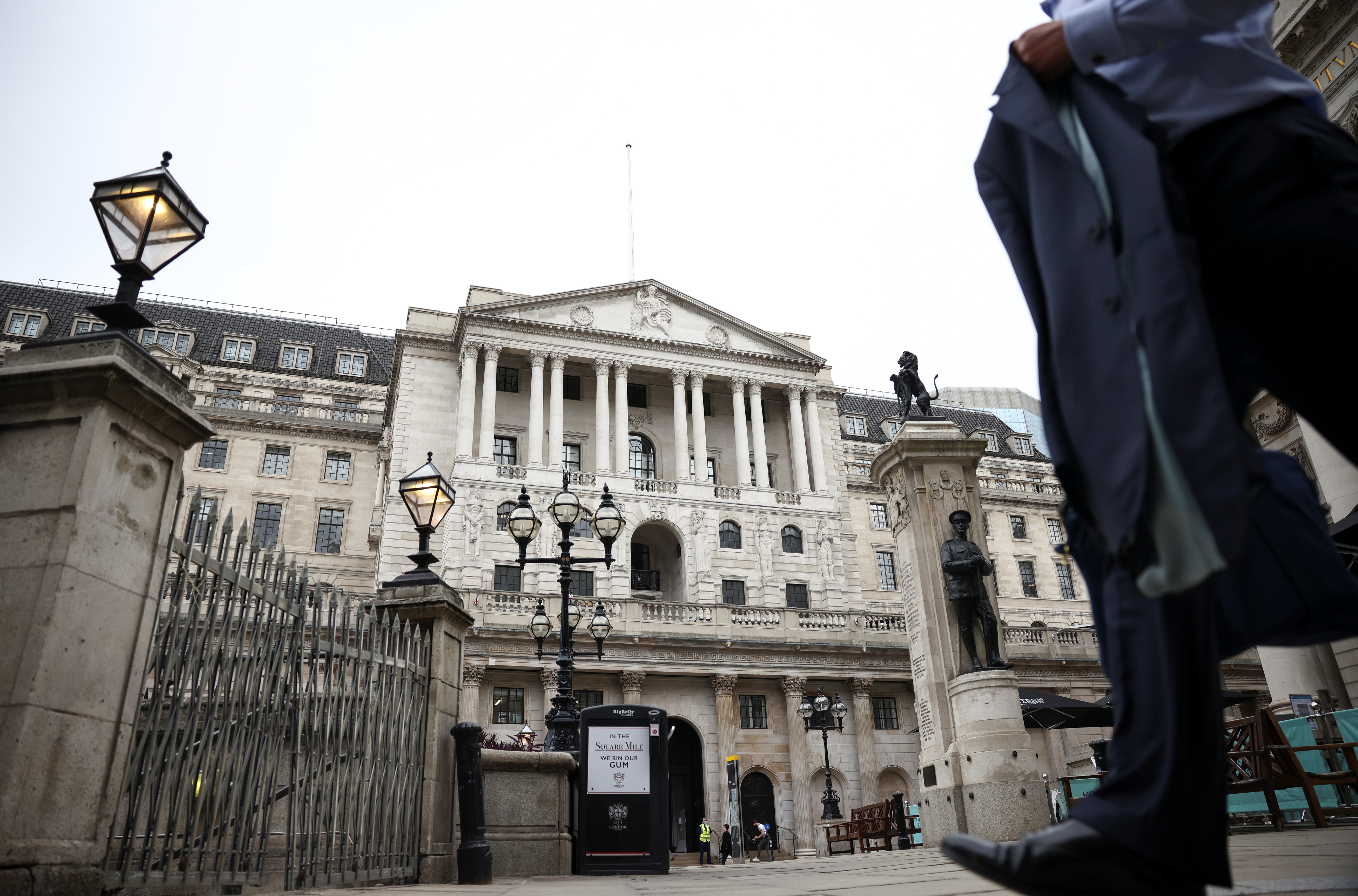 A person walks past the Bank of England in the City of London financial district, in London, Britain, June 11, 2021. REUTERS/Henry Nicholls