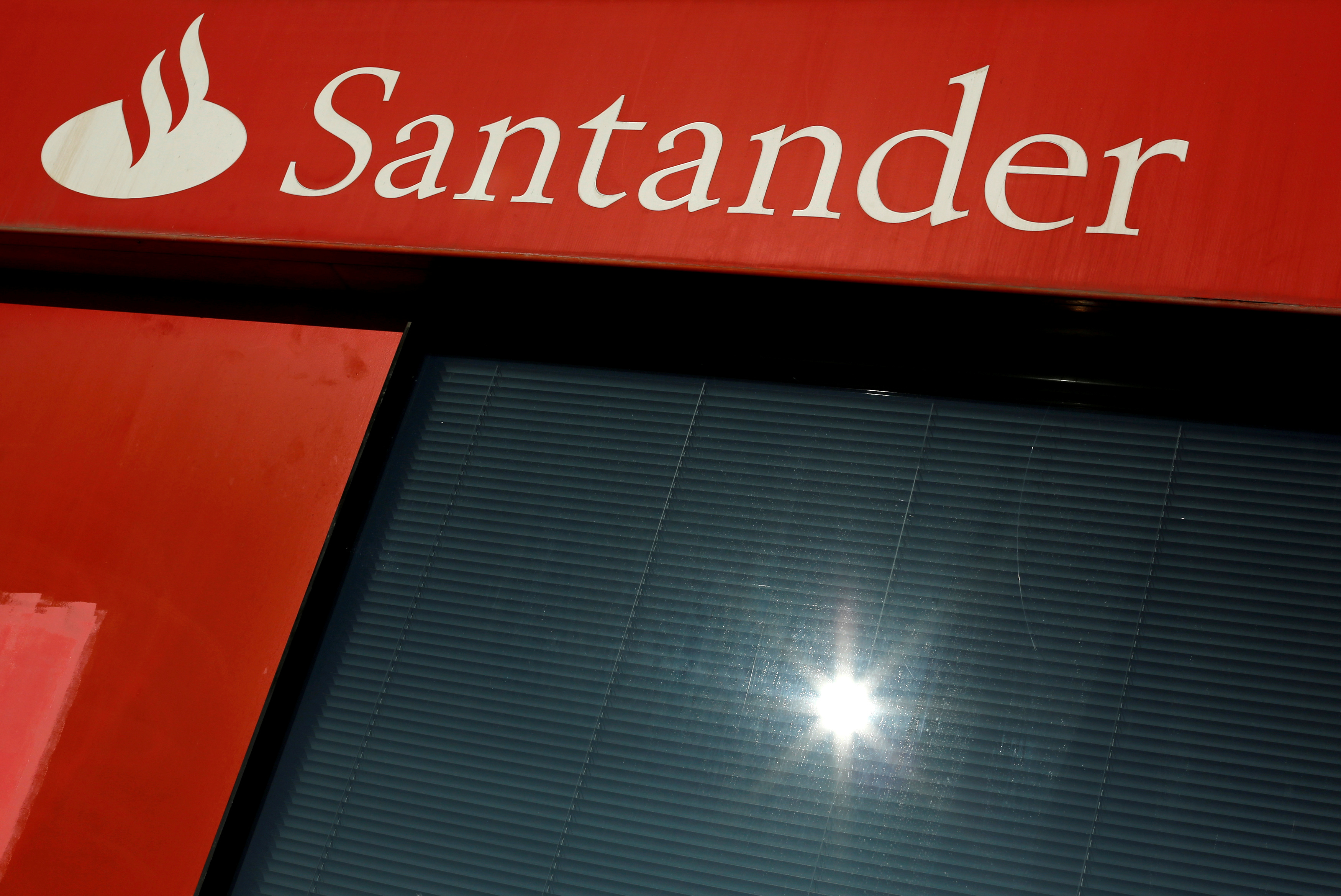 A logo of Santander is seen on a branch in the Andalusian capital of Seville, southern Spain January 27, 2016.  REUTERS/ Marcelo del Pozo/File Photo