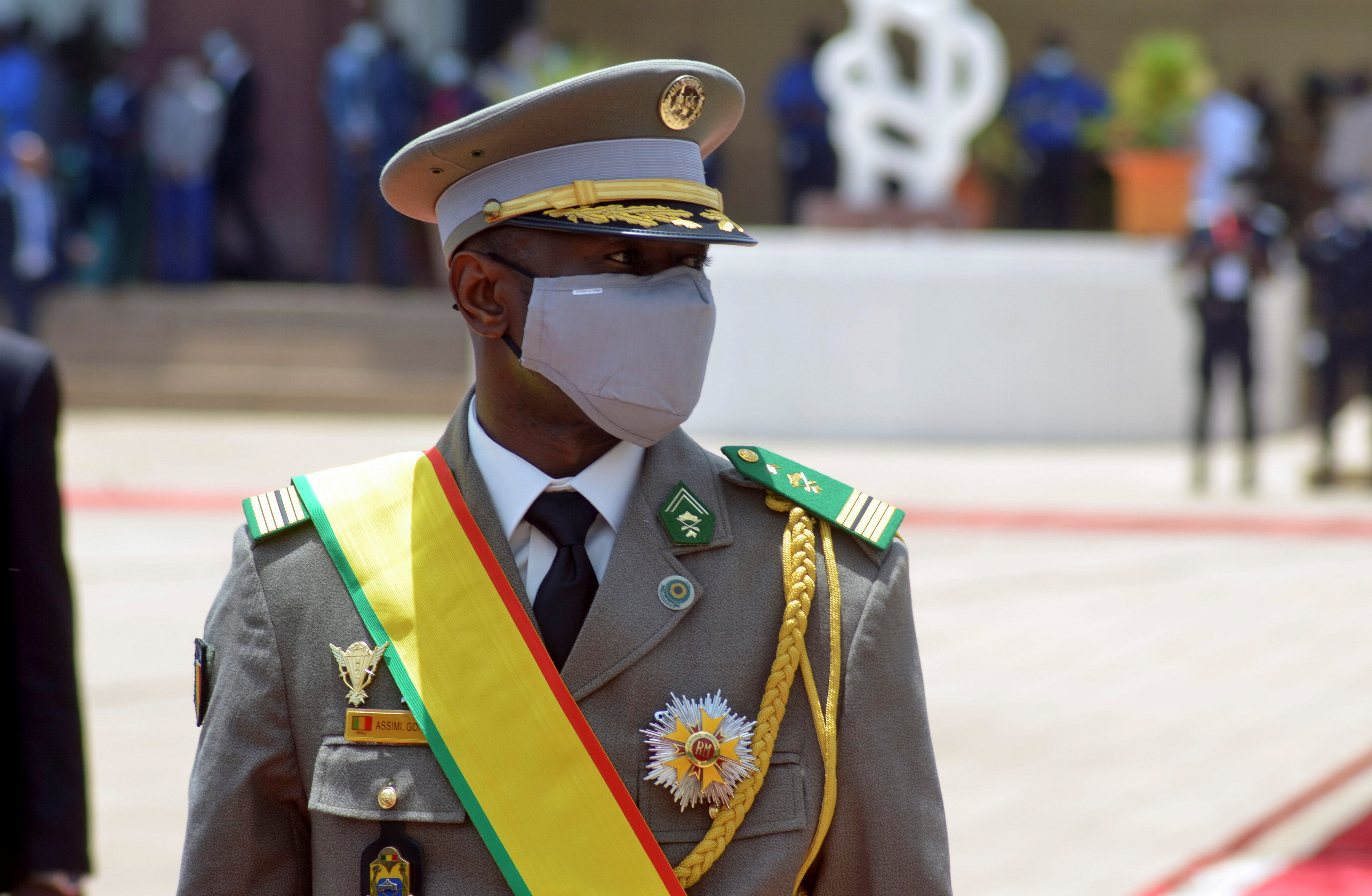 Colonel Assimi Goita, leader of two military coups and new interim president, walks during his inauguration ceremony in Bamako, Mali June 7, 2021. REUTERS/Amadou Keita