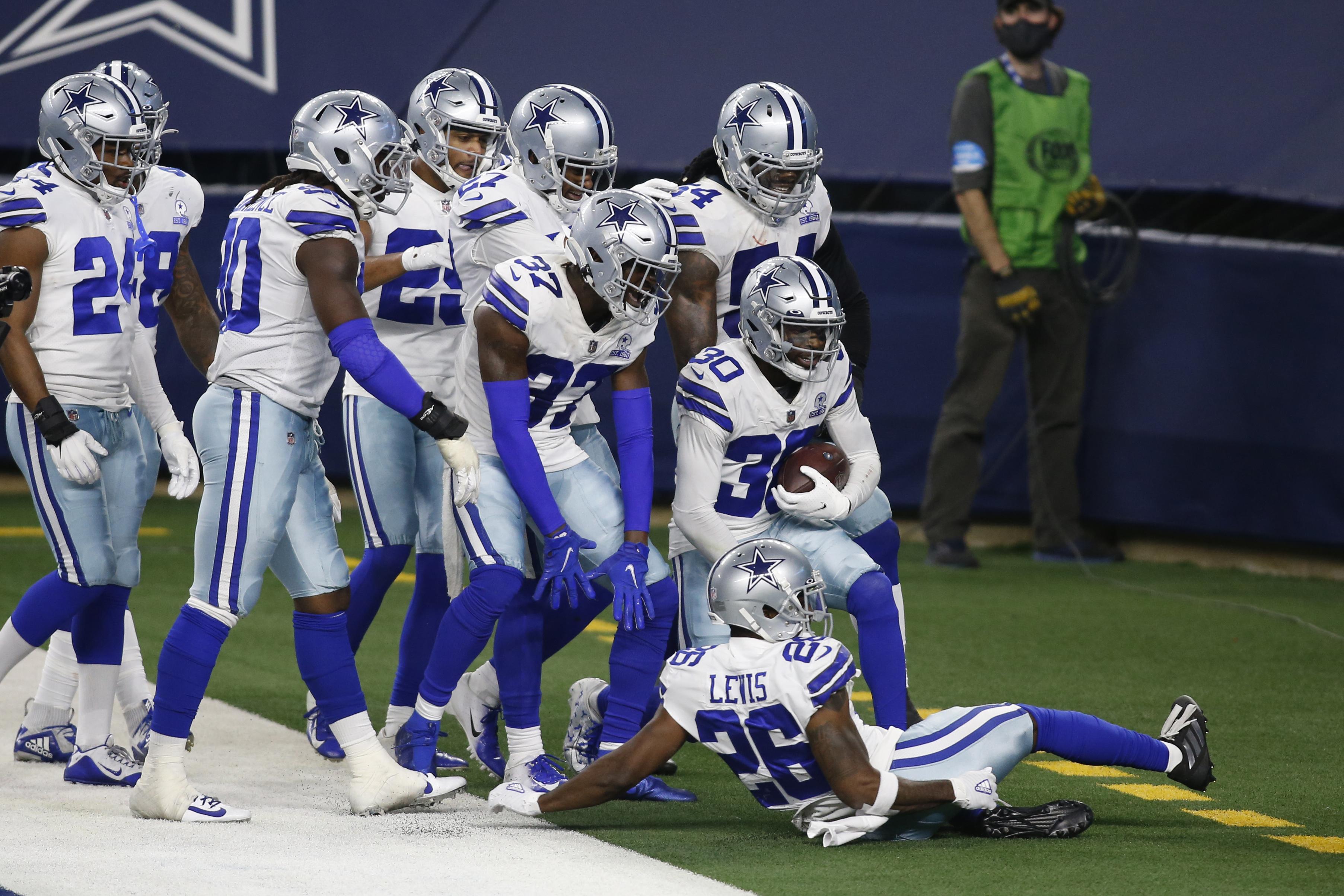 Dec 27, 2020; Arlington, Texas, USA; Dallas Cowboys cornerback Anthony Brown (30) celebrates an interception with teammates against the Philadelphia Eagles in the fourth quarter at AT&T Stadium. Mandatory Credit: Tim Heitman-USA TODAY Sports