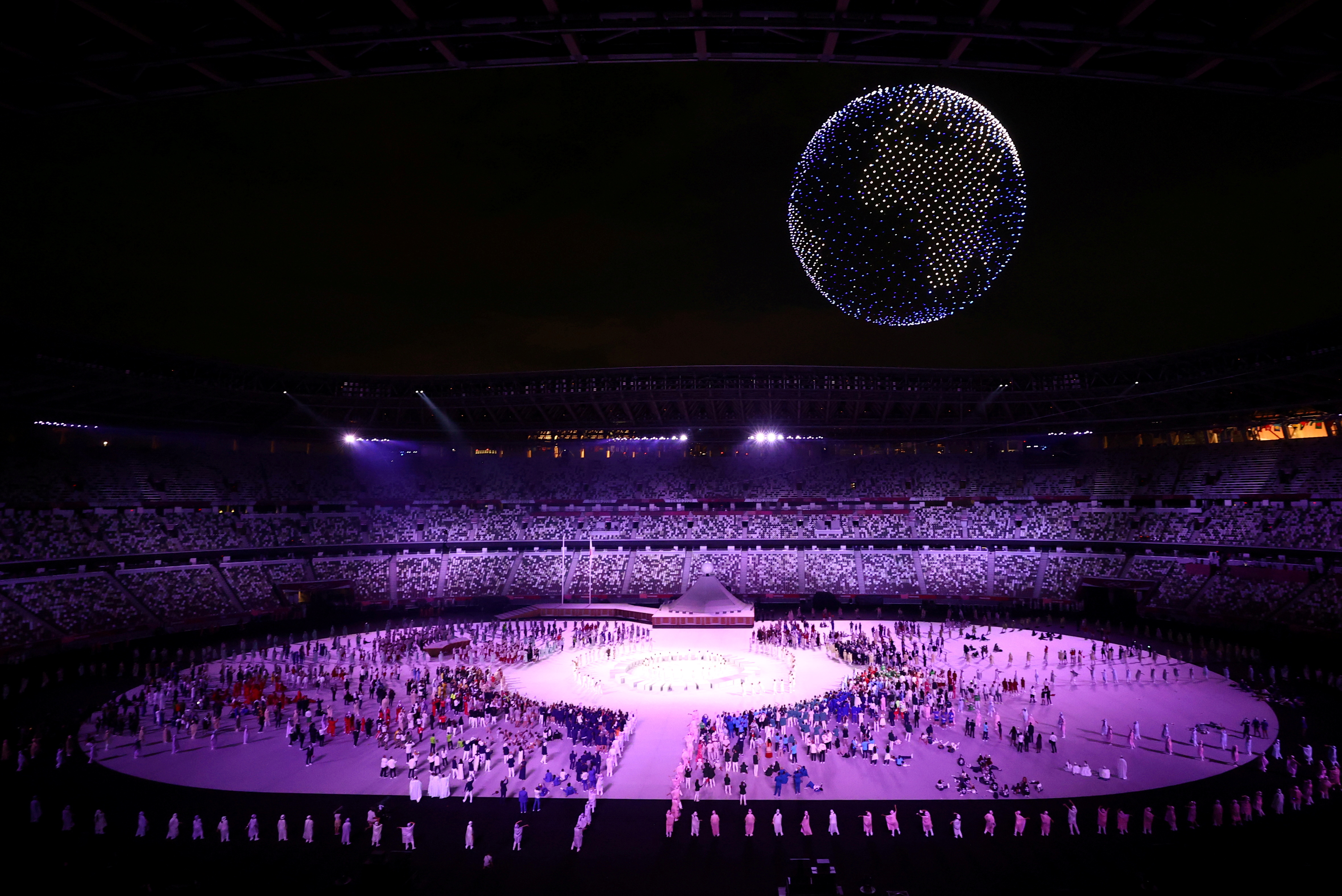 The Tokyo 2020 Olympics Opening Ceremony - Olympic Stadium, Tokyo, Japan - July 23, 2021. Drones are seen above the stadium during the opening ceremony REUTERS/Marko Djurica/File Photo