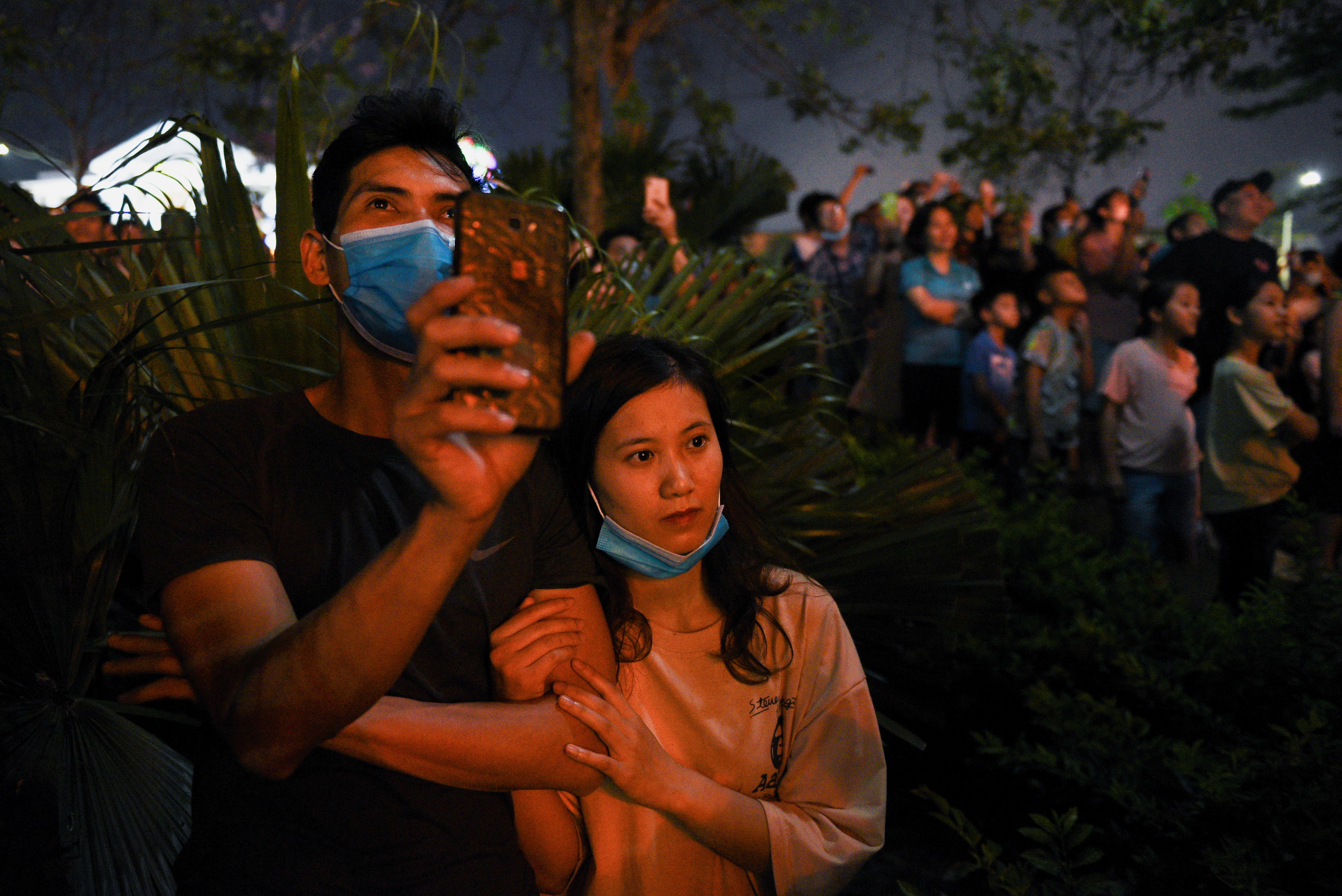 People attend a music show during Hung Kings' Festival in a first massive gathering, after coronavirus disease (COVID-19) restrictions were lifted, in Phu Tho province, Vietnam, April 20, 2021. REUTERS/Thanh Hue