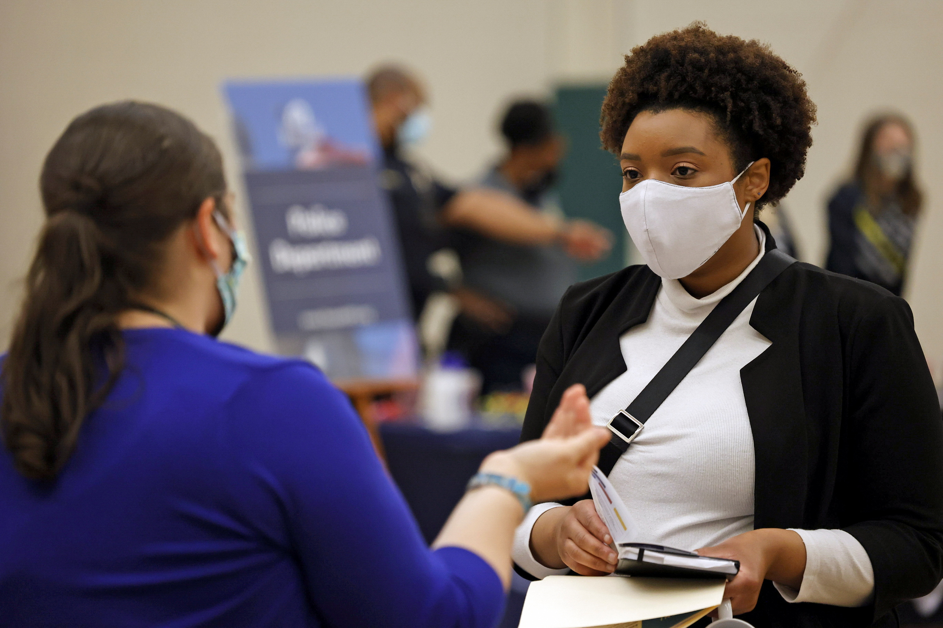 Britni Mann speaks with a potential employer during a job fair at Hembree Park in Roswell, Georgia, U.S. May 13, 2021.   REUTERS/Chris Aluka Berry