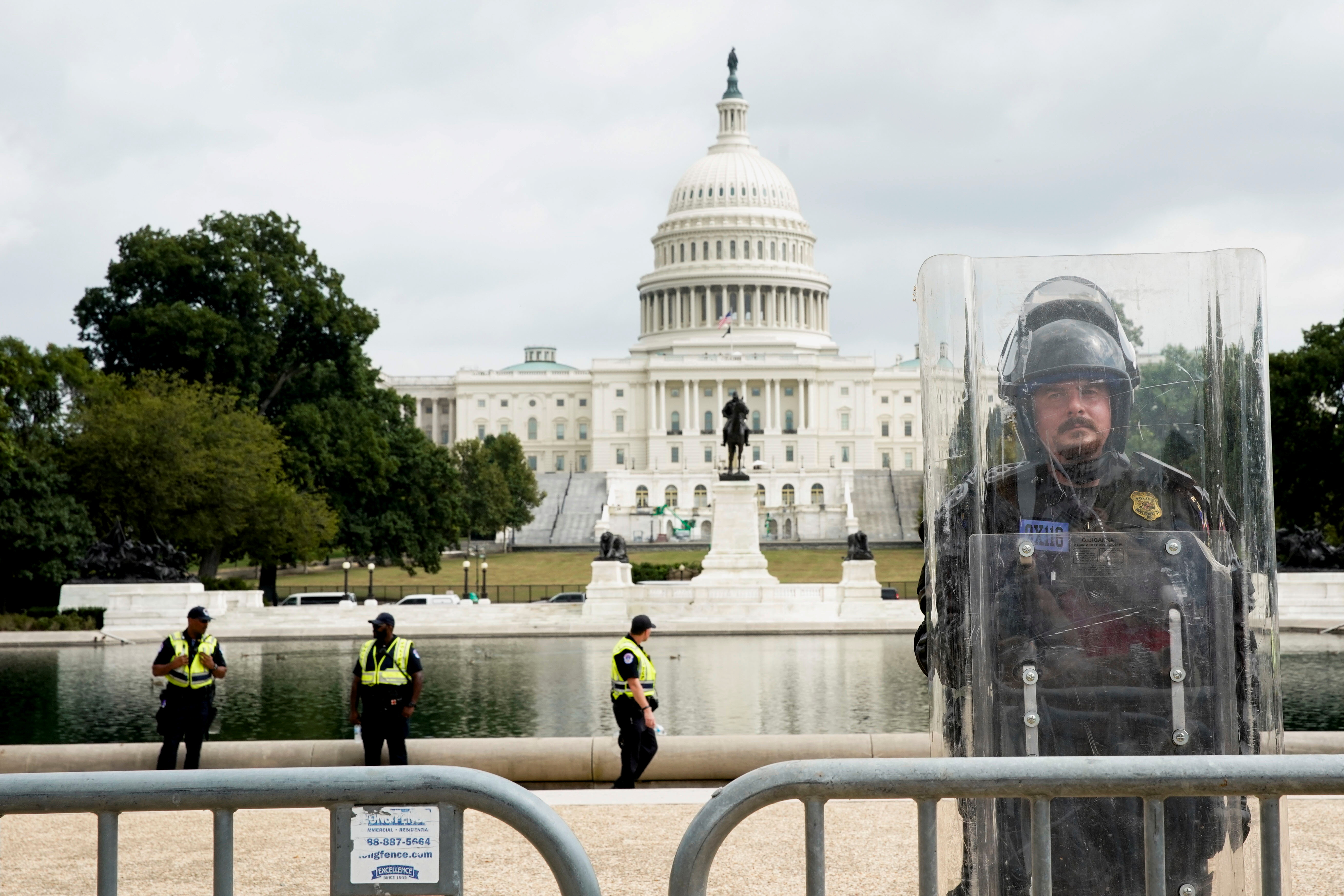 A riot police officer stands guard during a rally in support of defendants being prosecuted in the January 6 attack on the Capitol, in Washington, U.S., September 18, 2021. REUTERS/Elizabeth Frantz