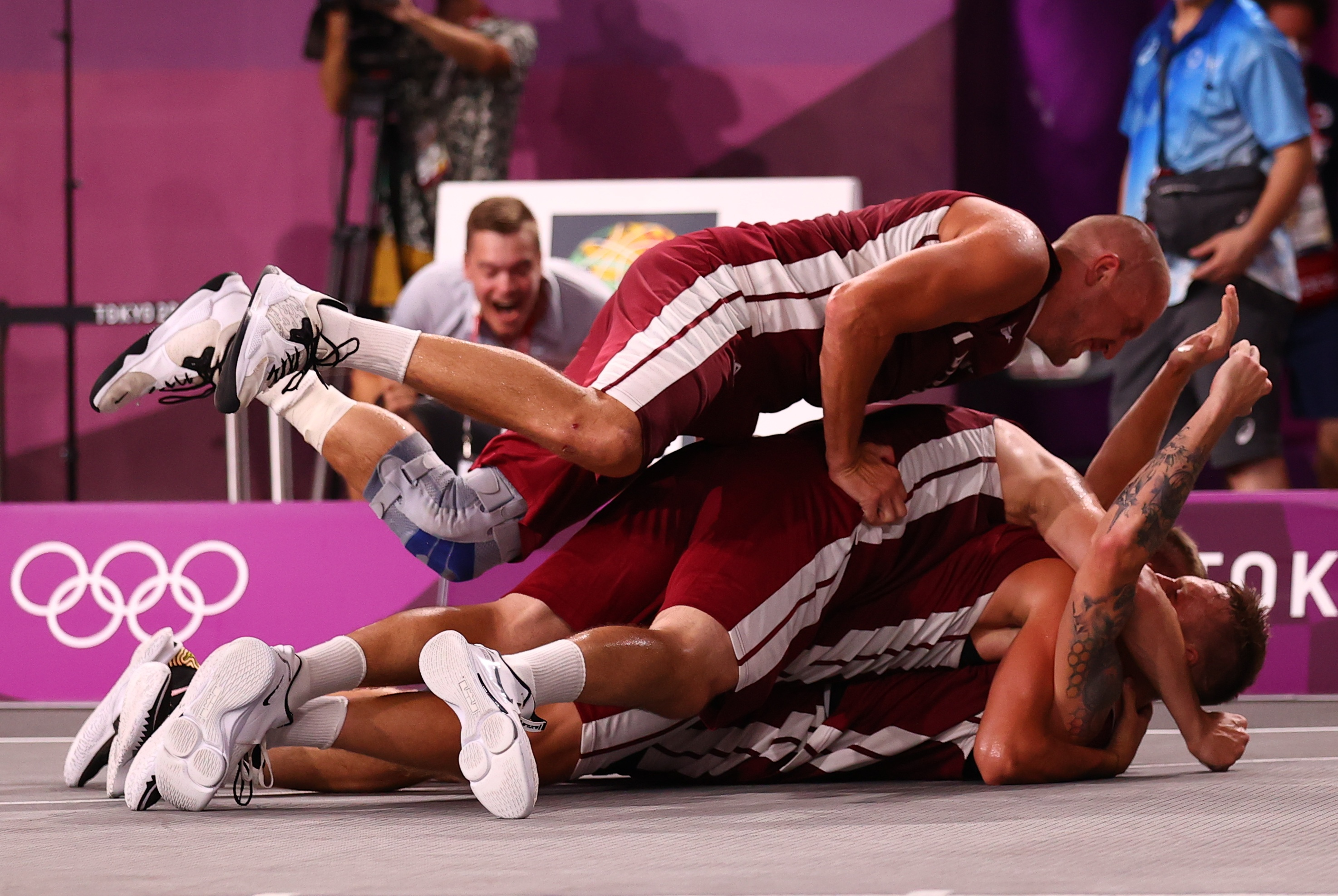 Tokyo 2020 Olympics - Basketball 3x3 - Men - Finals - The Russian Olympic Committee v Latvia - Aomi Urban Sports Park, Tokyo Japan - July 28, 2021. Players of Latvia celebrate victory after the match.