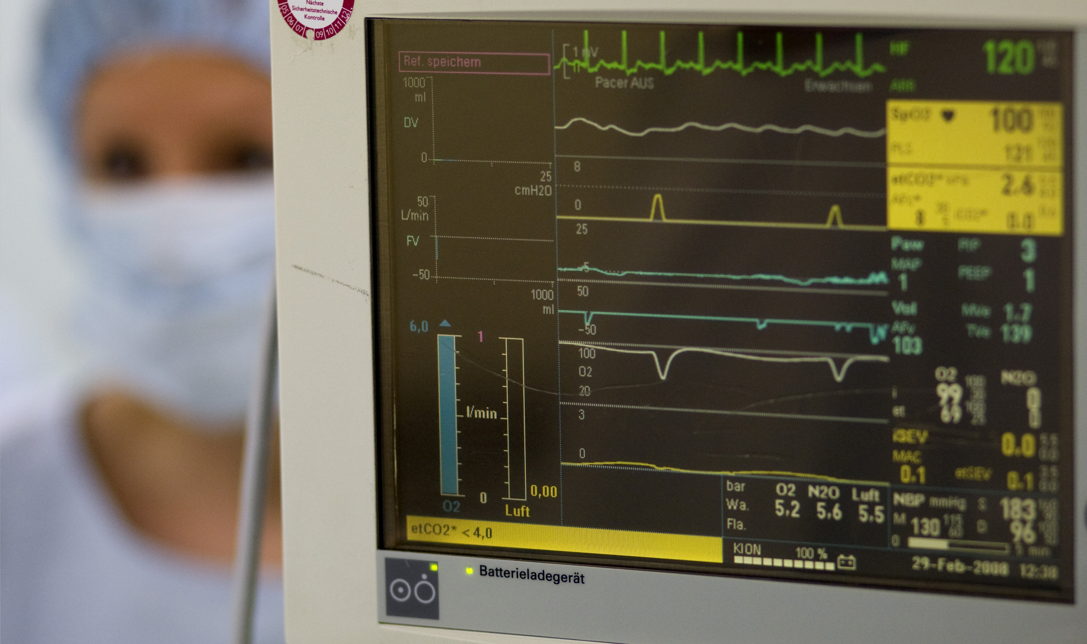 A surgery nurse beside a heart beat monitor in the operating theatre of the Unfallkrankenhaus Berlin (UKB) hospital in Berlin, February 29, 2008. REUTERS/Fabrizio Bensch