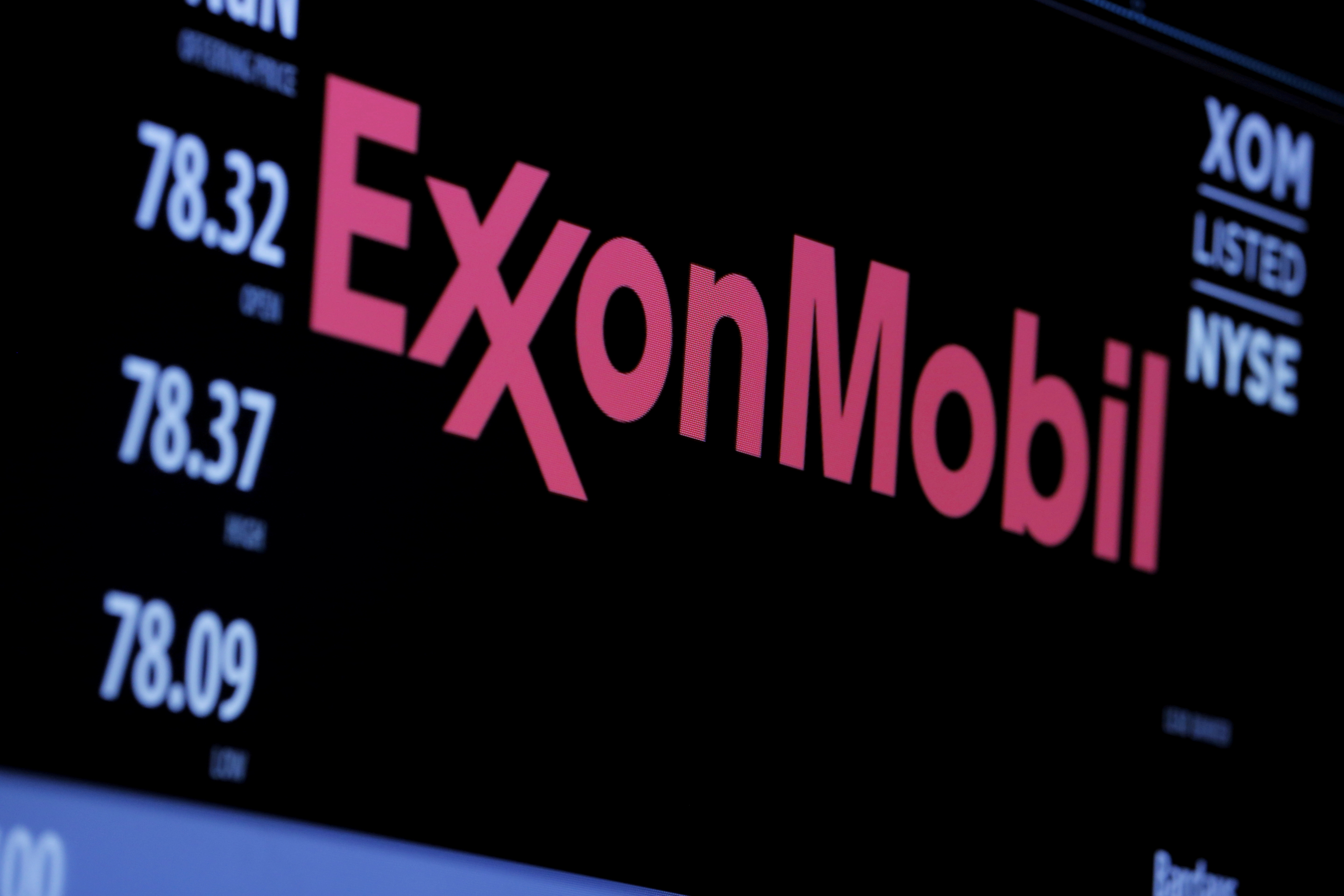 The logo of Exxon Mobil Corp is shown on a monitor above the floor of the New York Stock Exchange in New York, December 30, 2015.