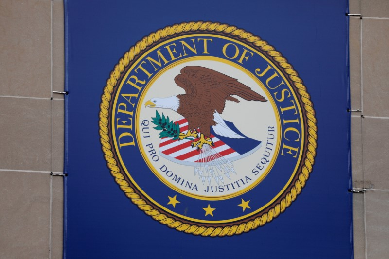 The crest of the United States Department of Justice (DOJ) is seen at their headquarters in Washington, May 10, 2021. REUTERS/Andrew Kelly