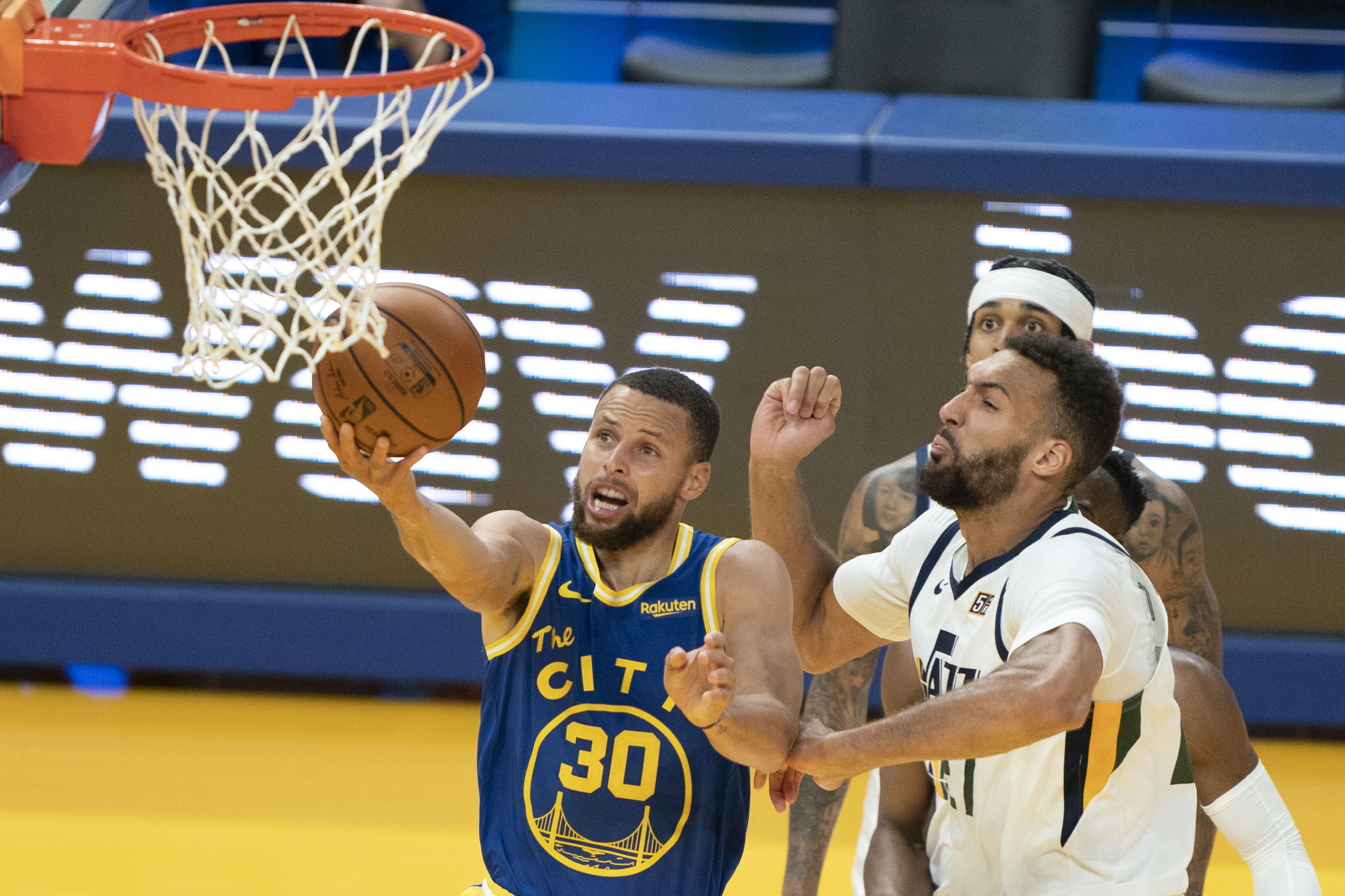 May 10, 2021; San Francisco, California, USA; Golden State Warriors guard Stephen Curry (30) shoots the basketball against Utah Jazz center Rudy Gobert (27) during the third quarter at Chase Center. Mandatory Credit: Kyle Terada-USA TODAY Sports