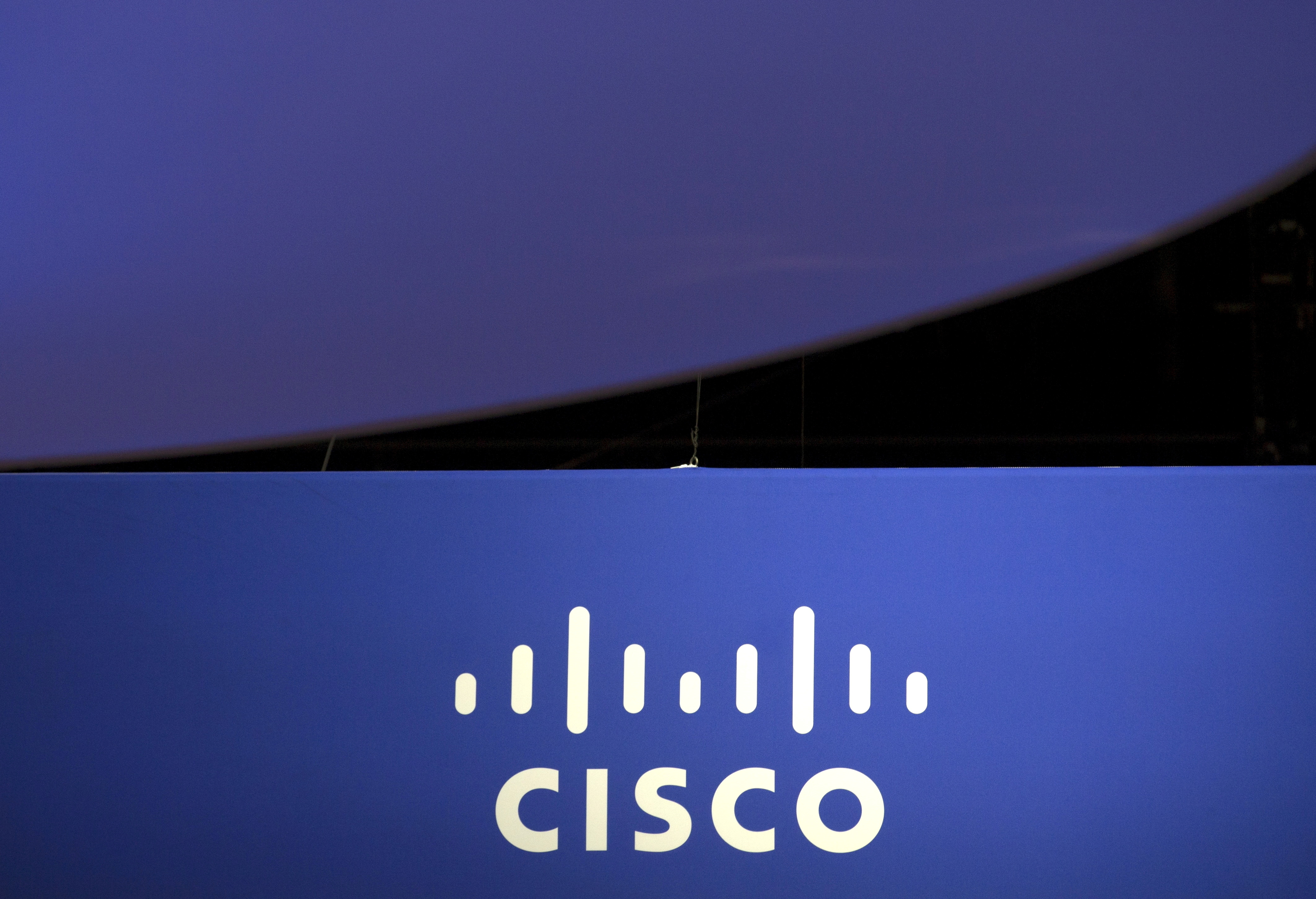 The Cisco Systems logo is seen as part of a display at the Microsoft Ignite technology conference in Chicago, Illinois, U.S., May 4, 2015. REUTERS/Jim Young