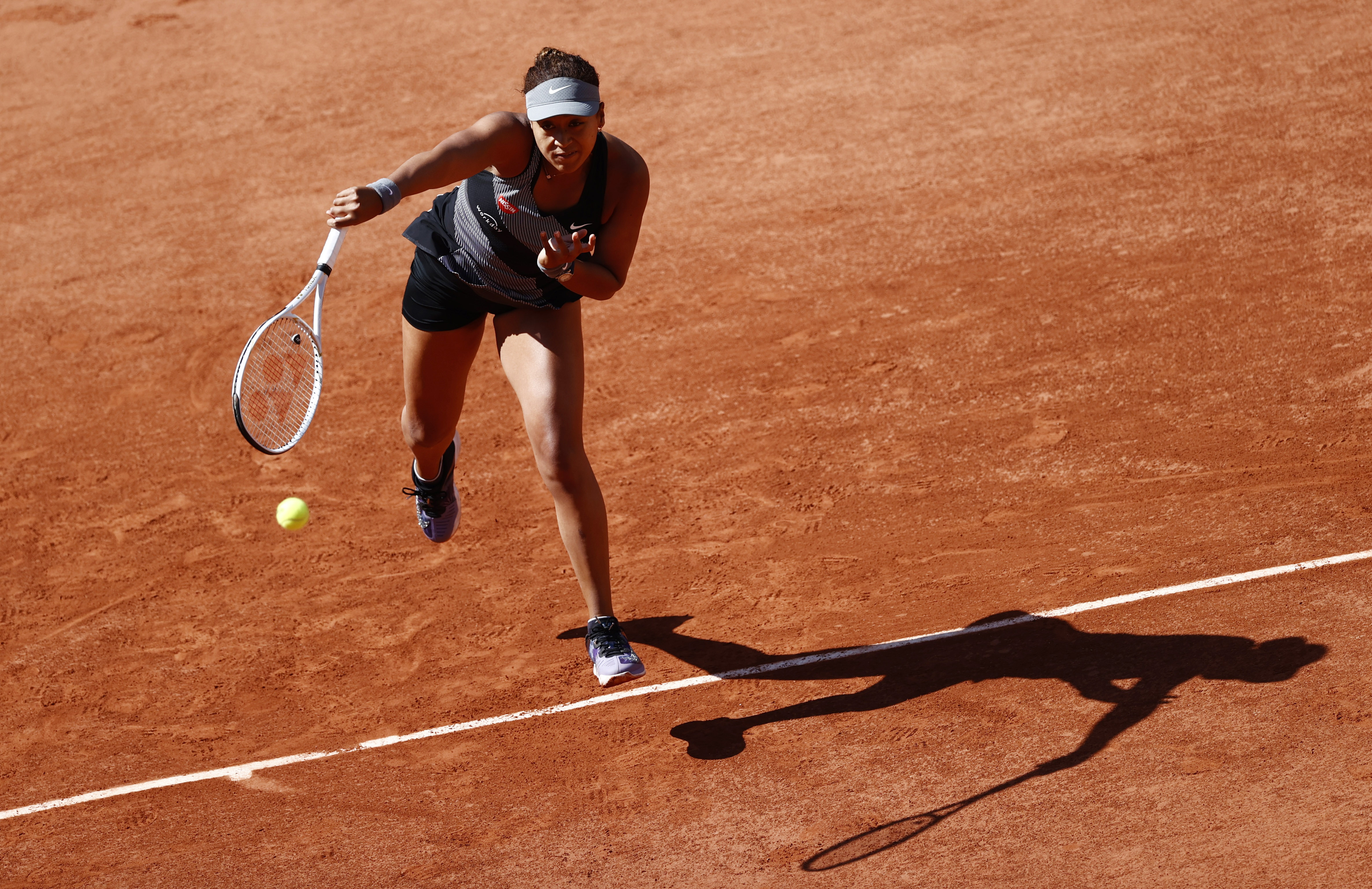Tennis - French Open - Roland Garros, Paris, France - May 30, 2021 Japan's Naomi Osaka in action during her first round match against Romania's Patricia Maria Tig REUTERS/Christian Hartmann