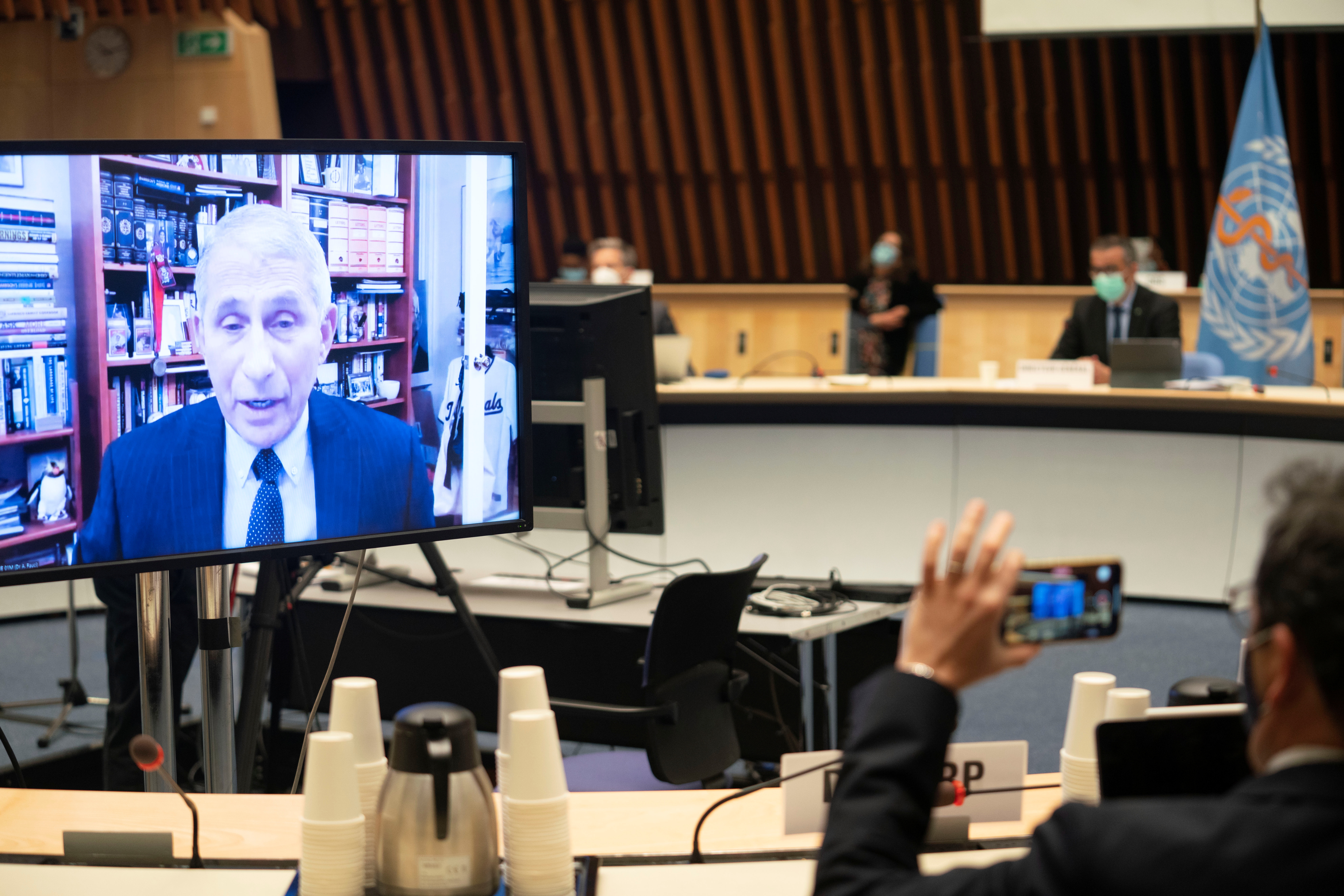Dr. Anthony Fauci, director of the National Institute of Allergy and Infectious Diseases speaks via video link during the 148th session of the Executive Board on the coronavirus disease (COVID-19) outbreak in Geneva, Switzerland, January 21, 2021.  Christopher Black/WHO/Handout via REUTERS