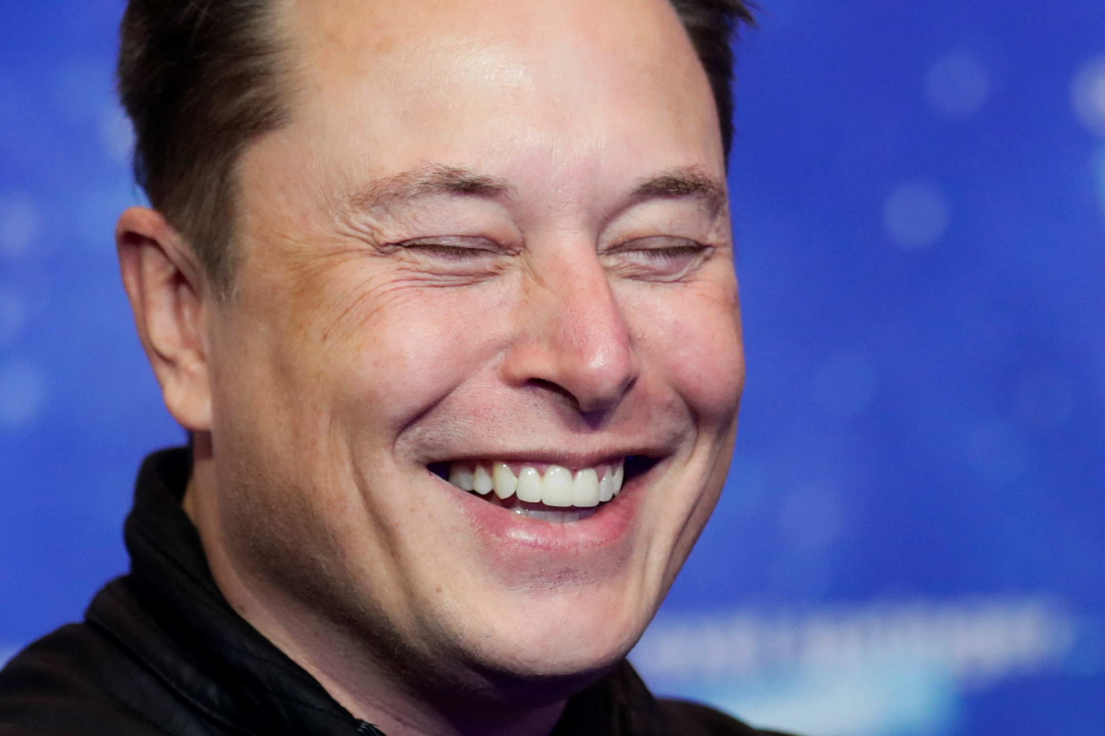SpaceX owner and Tesla CEO Elon Musk laughs after arriving on the red carpet for the Axel Springer award, in Berlin, Germany, December 1, 2020.