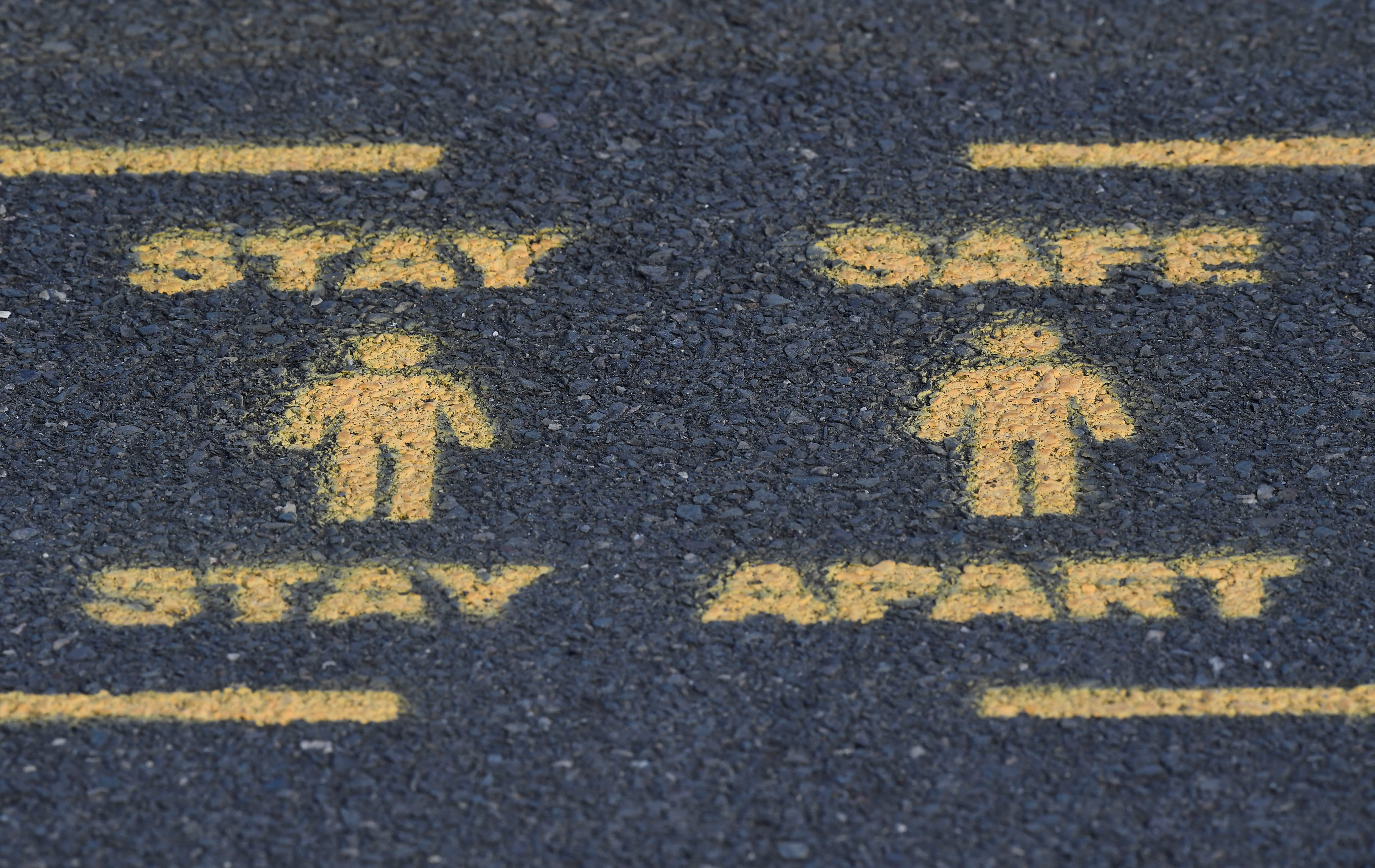 Public health signs are sprayed on sidewalks while reproduction.
