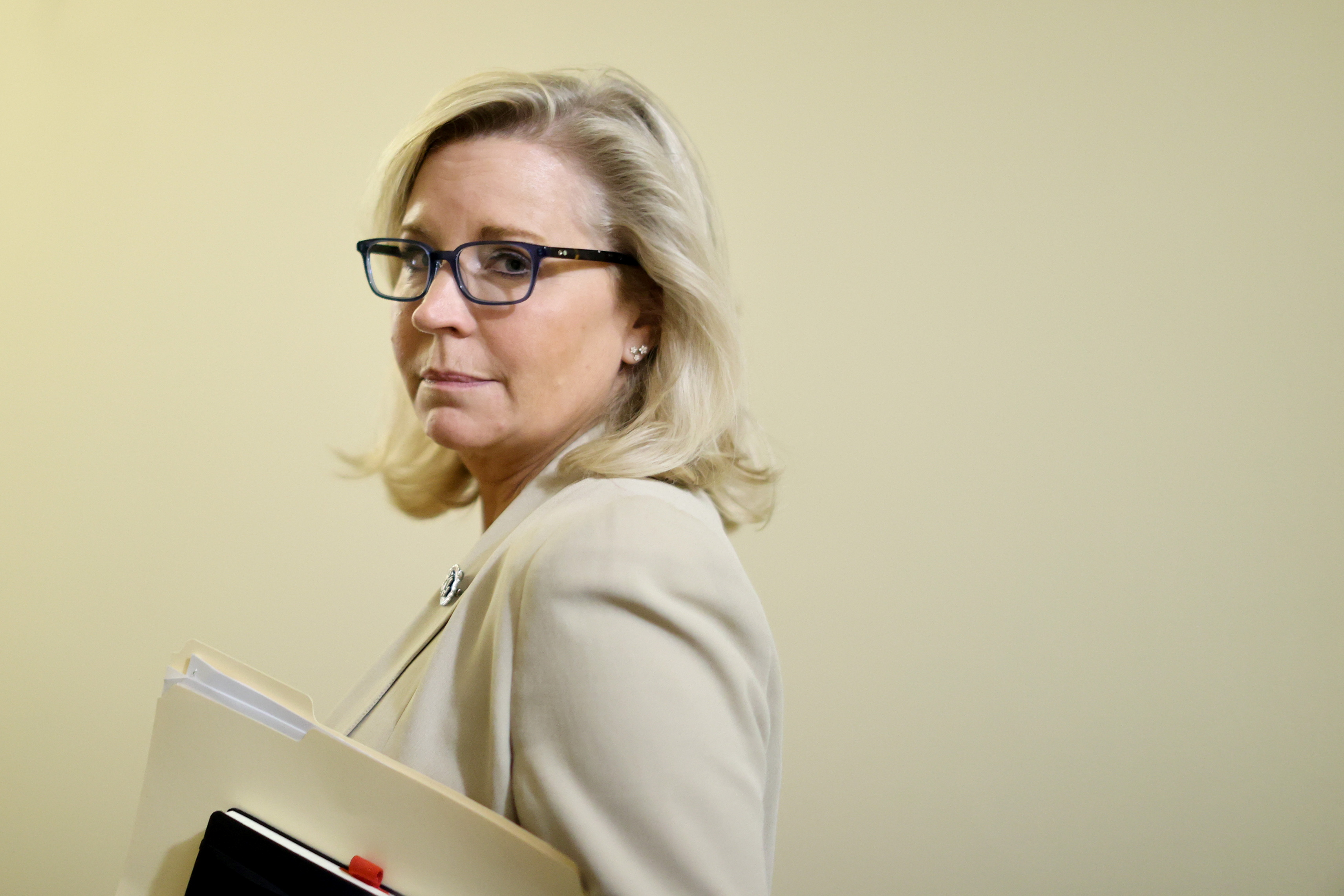 U.S. Representative Liz Cheney (R-WY) listens to a reporter's question as she departs after meeting with fellow Select Committee to Investigate the January 6th Attack on the U.S. Capitol members and House Speaker Nancy Pelosi (D-CA) at the Capitol in Washington, U.S. July 1, 2021.  REUTERS/Jonathan Ernst