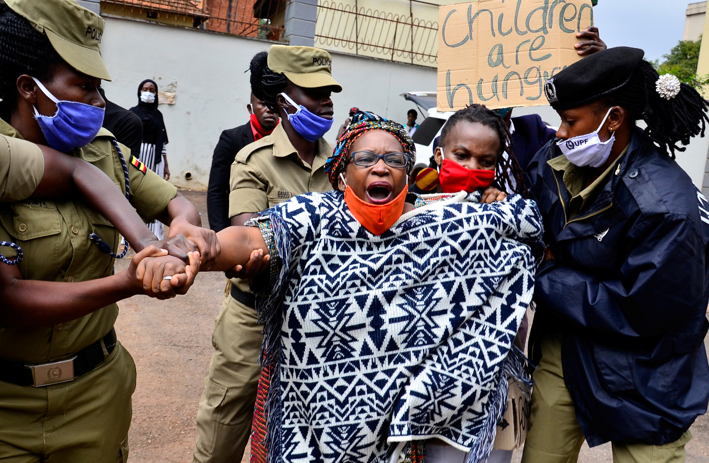 Ugandan police detain academic Stella Nyanzi protesting against the way that government distributes the relief food and the lockdown situation to control the spread of the coronavirus disease (COVID-19) outbreak in Kampala, Uganda. May 18, 2020. REUTERS/Abubaker Lubowa