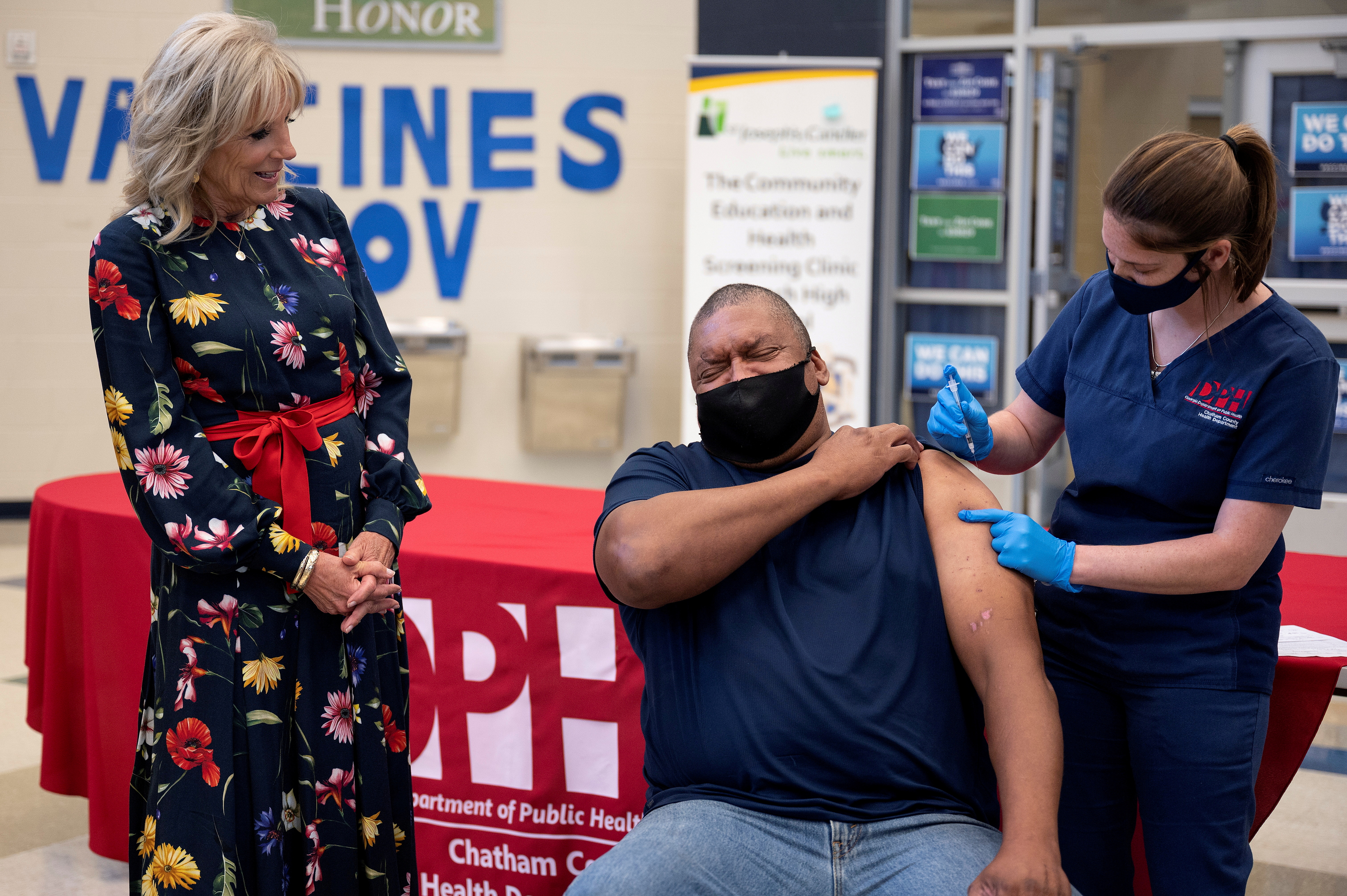 U.S. first lady Jill Biden looks on as Alfred Lee Smith is vaccinated with the Johnson & Johnson COVID-19 vaccination at a vaccination facility at Alfred E. Beach High School in Savannah, Georgia, U.S. July 8, 2021.  Jim Watson/Pool via REUTERS     TPX IMAGES OF THE DAY/File Photo